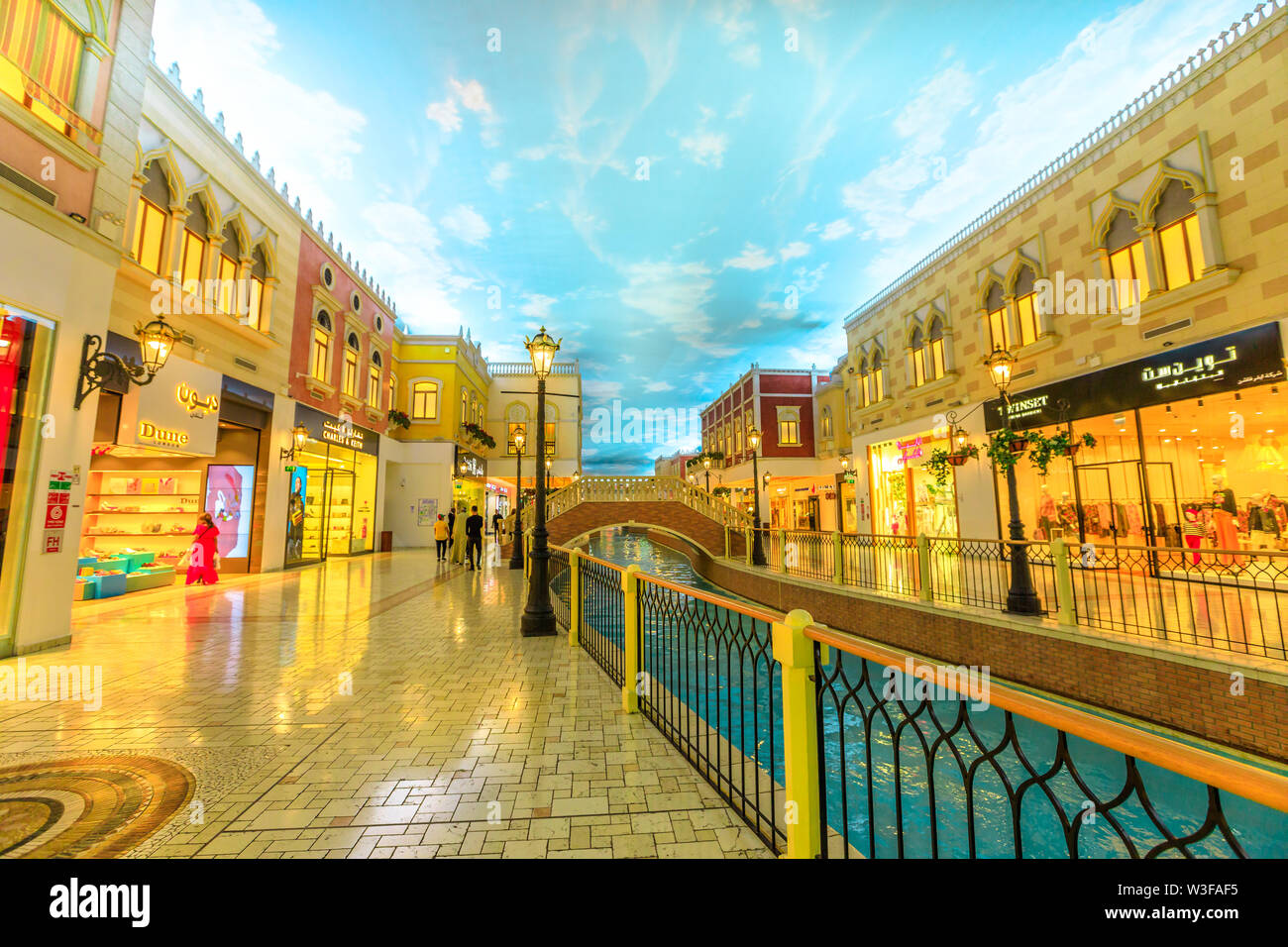 Doha, Qatar - February 21, 2019: venice canal in Villaggio Mall, shopping center in Aspire Zone. Luxury brands, expensive stores and exclusive shops i - Stock Image