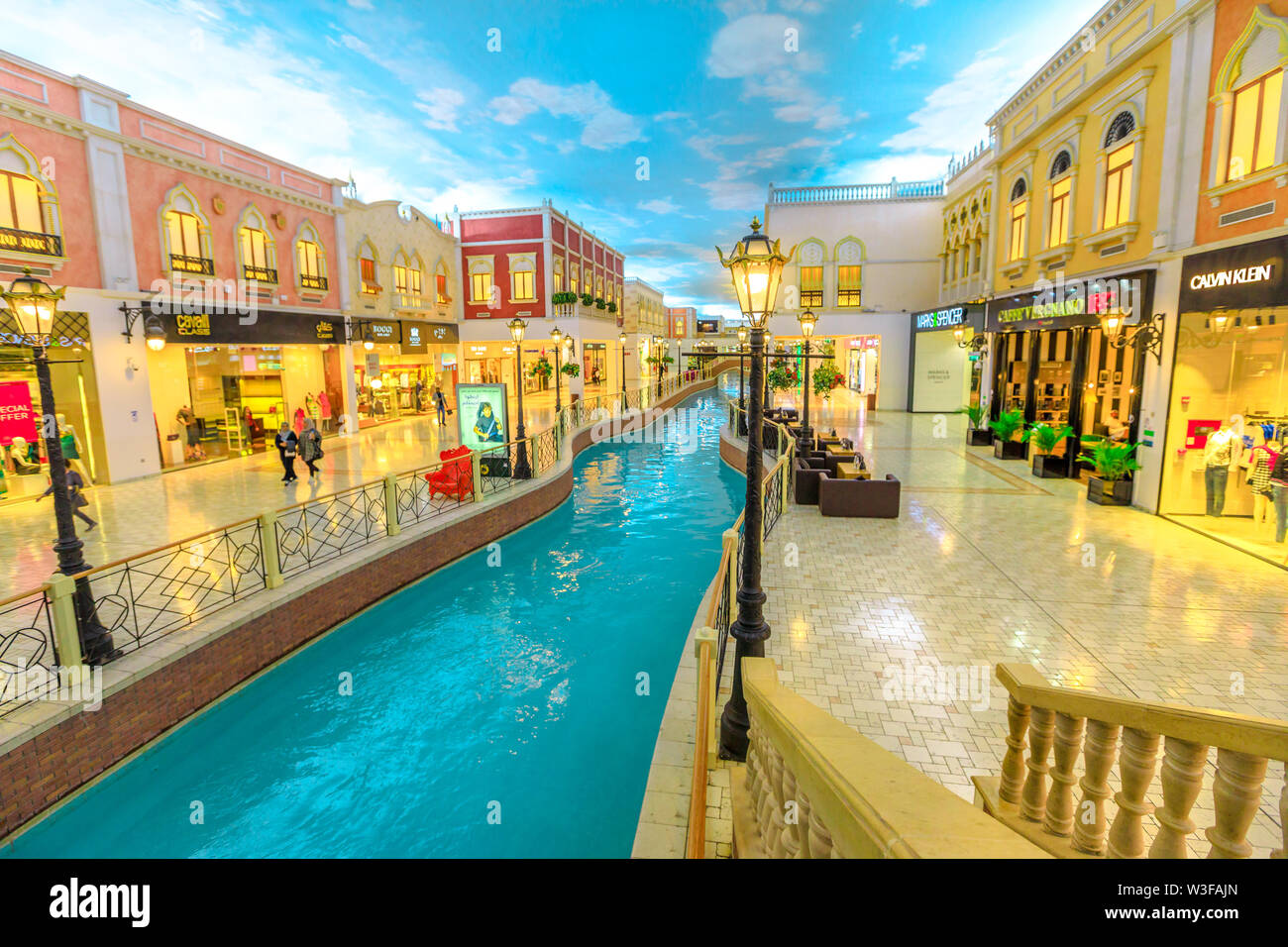 Doha, Qatar - February 21, 2019: venice canal in Villaggio Mall, a shopping center in Aspire Zone. Luxury brands, expensive stores and exclusive shops - Stock Image
