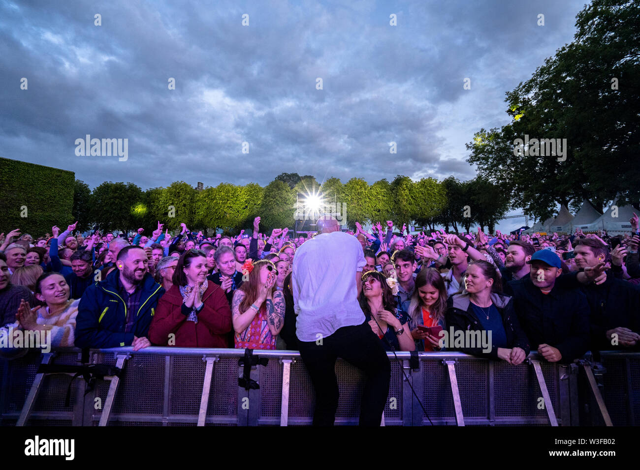 Bergen, Norway - June 13th, 2019. The Norwegian rock Madrugada performs a live concert during the Norwegian music festival Bergenfest 2019 in Bergen. Here singer and songwriter Sivert Høyem is seen among the festival goers. (Photo credit: Gonzales Photo - Jarle H. Moe). - Stock Image