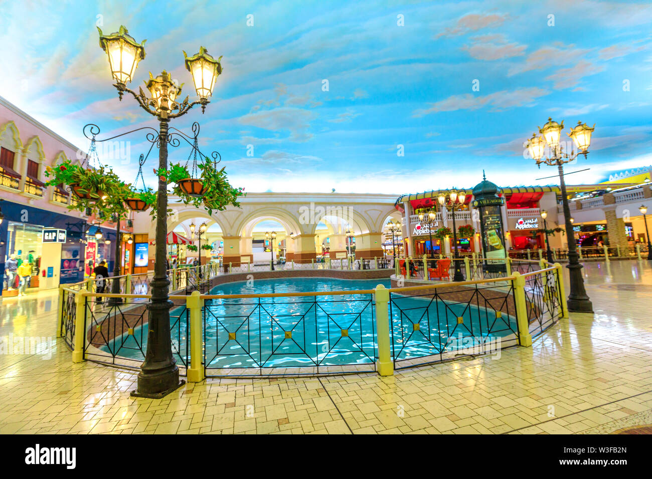 Doha, Qatar - February 21, 2019: vintage lamps and venice canal in Villaggio Mall, a shopping center in Aspire Zone. Luxury brands, expensive stores a - Stock Image