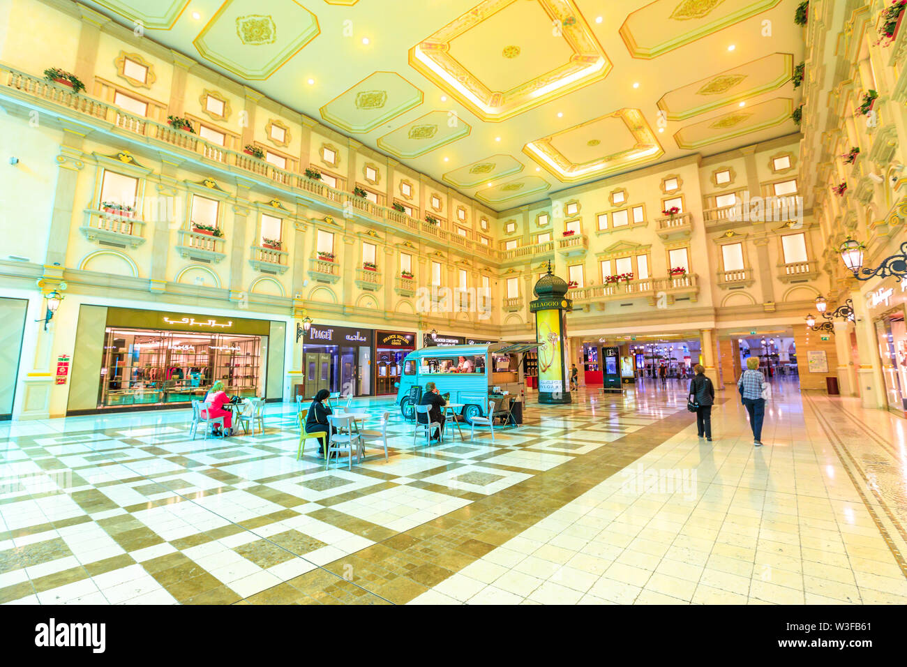 Doha, Qatar - February 21, 2019: lifestyle people inside famous Villaggio Mall, a shopping center in Aspire Zone, Doha Sports City. Luxury shops with - Stock Image