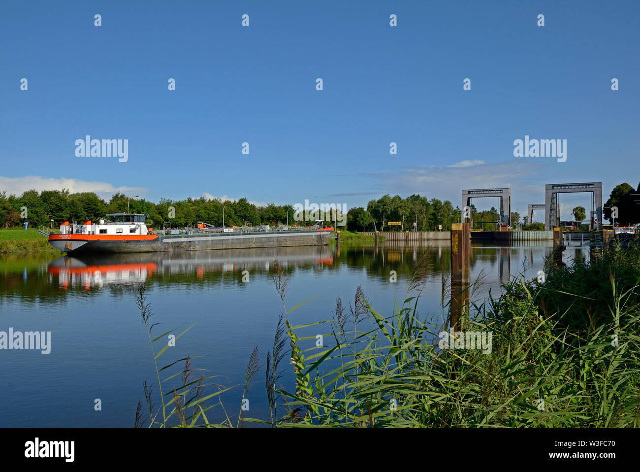 papenburg, niedersachsen/germany - august 24, 2014: the most northerly locks at the end of  dortmund ems canal at km 213.5 near herbrum and a inland w - Stock Image