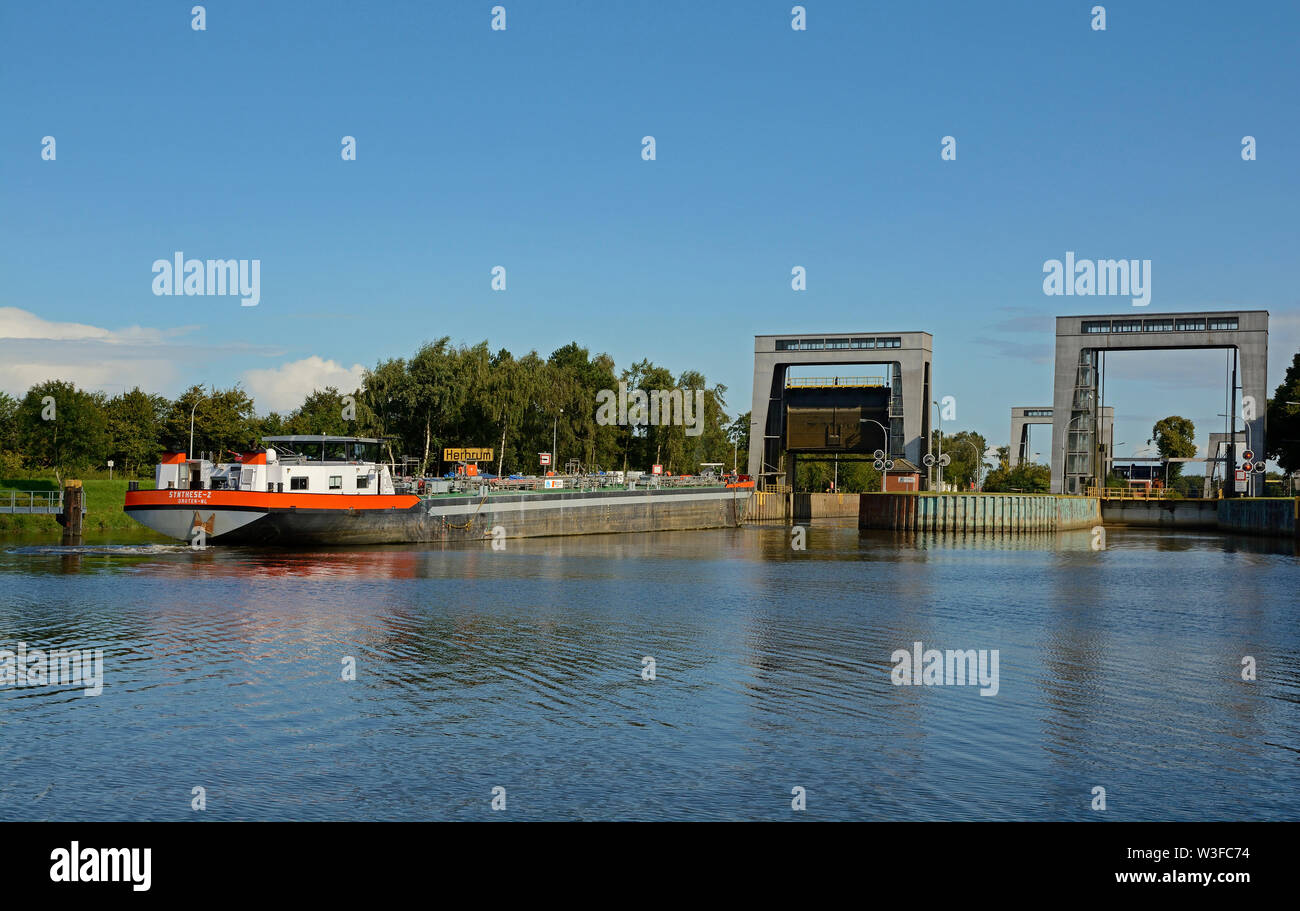 papenburg, niedersachsen/germany - august 24, 2014: the most northerly locks at the end of  dortmund ems canal at km 213.5 near herbrum and a inland w Stock Photo