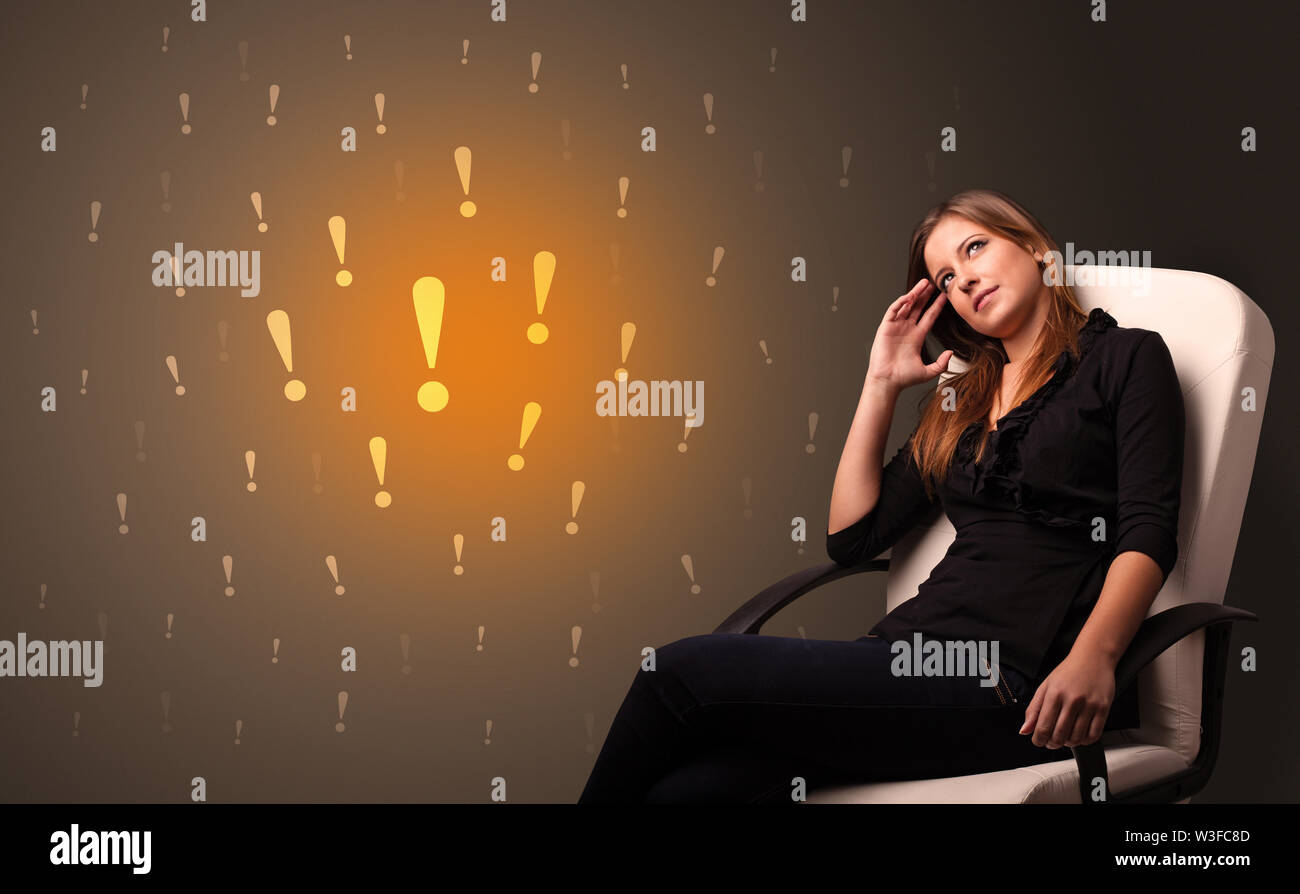 Young person standing with exclamation sign concept - Stock Image