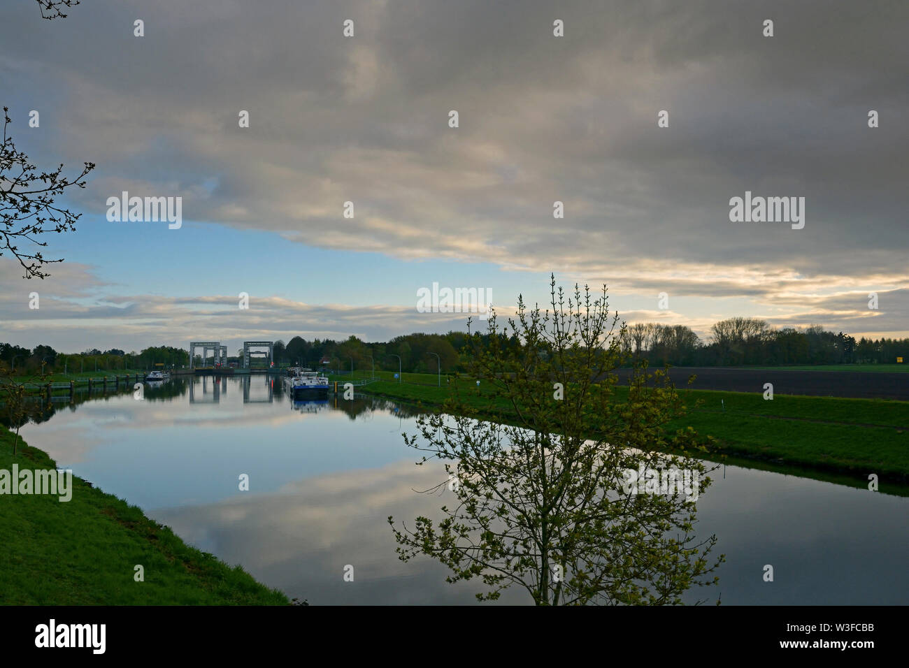 papenburg, niedersachsen/germany - may 01, 2015: river ems and dortmund ems canal respectively with herbrum locks in the background - Stock Image