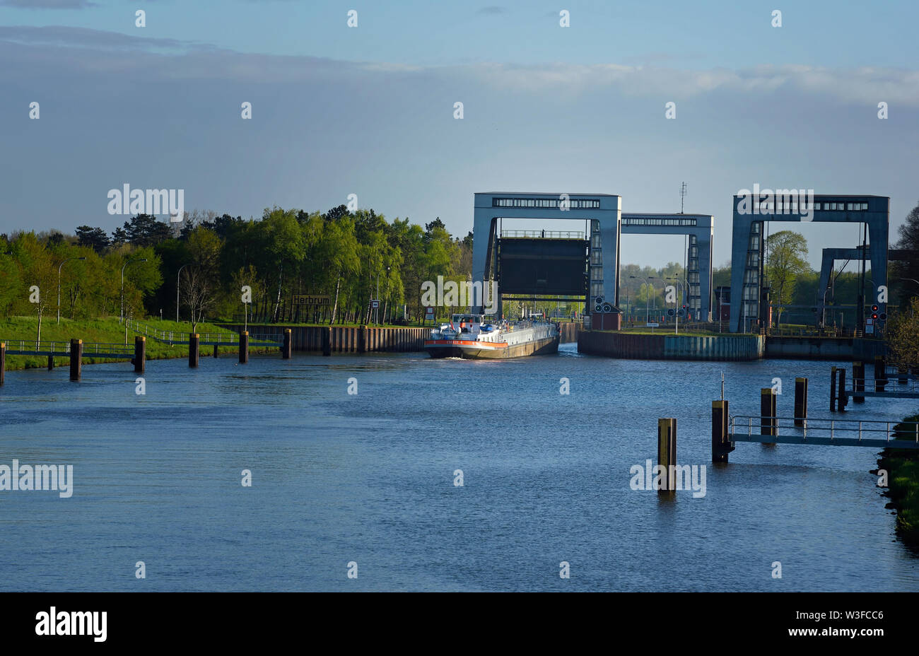 papenburg, niedersachsen/germany - may 04, 2015: the most northerly locks at the end of  dortmund ems canal at km 213.5 near herbrum and a inland wate Stock Photo