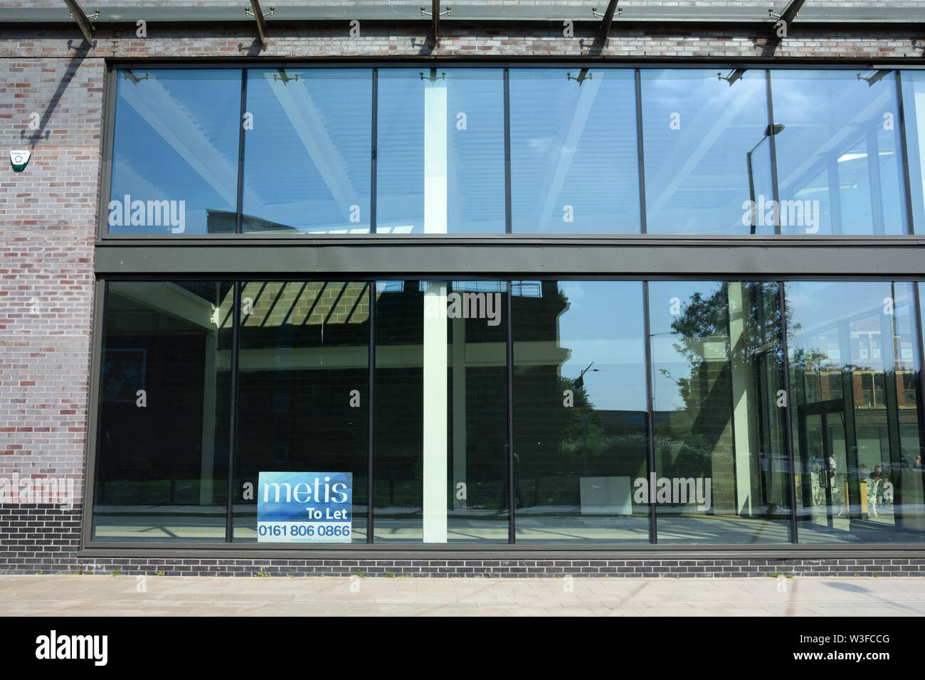 Glass curtain wall on empty to let commercial building in bury lancashire uk Stock Photo