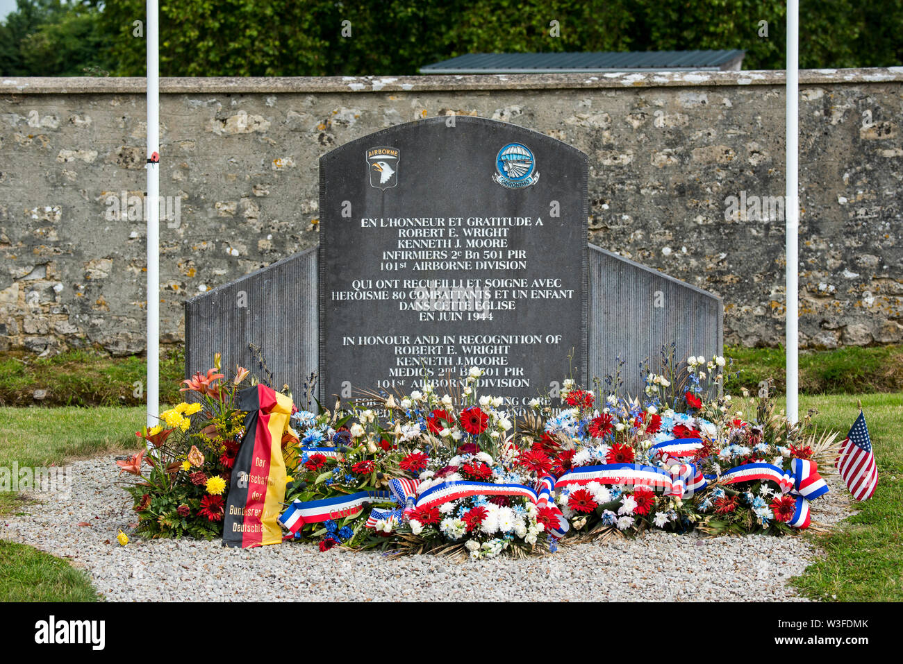 WW2 memorial dedicated to Kenneth Moore and Robert Wright, two US Army Medics at Angoville-au-Plain, Manche, Normandy, France - Stock Image
