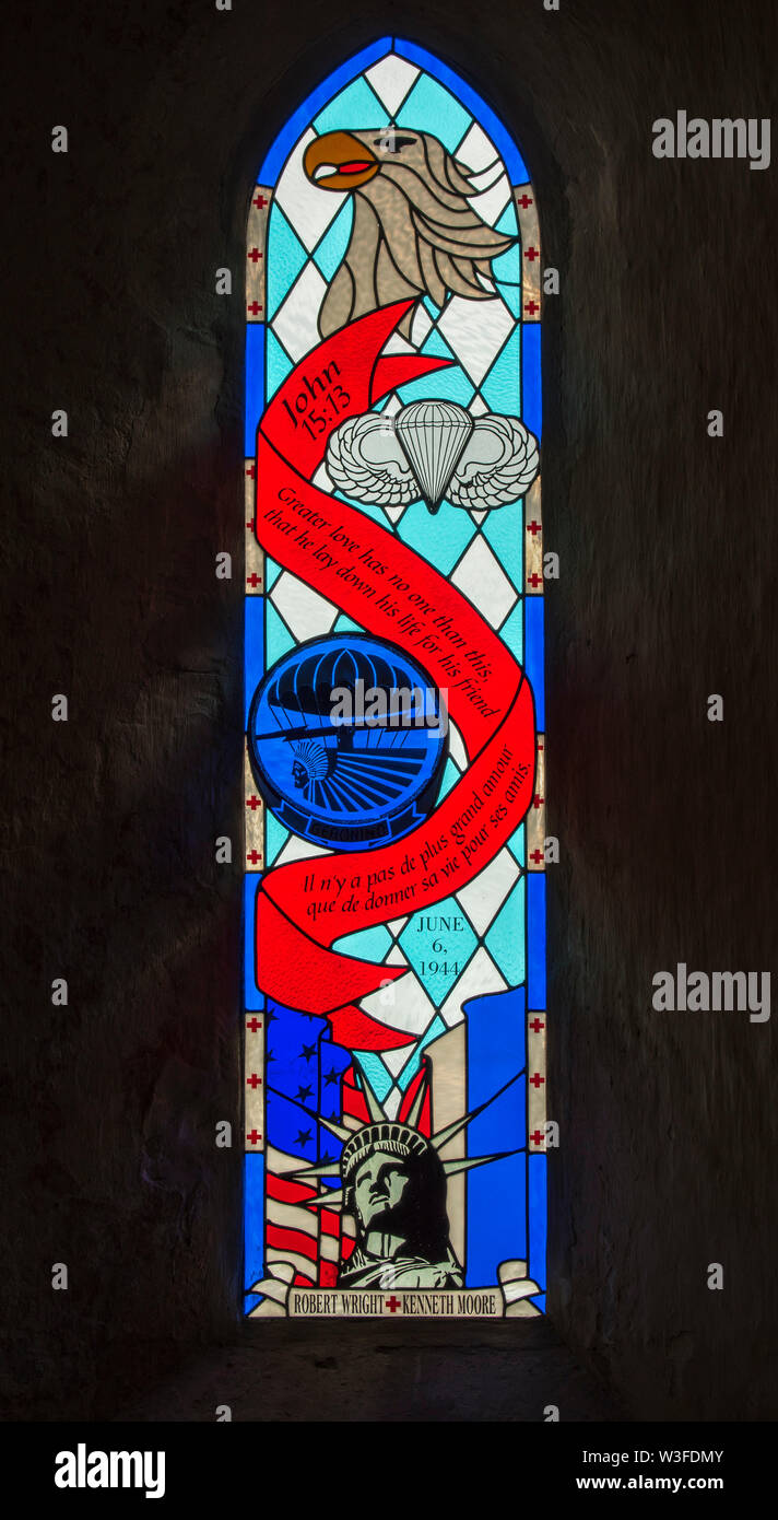 Stained glass window dedicated to Robert Wright and Ken Moore, WW2 US Army medics in the church at Angoville-au-Plain, Manche, Normandy, France - Stock Image