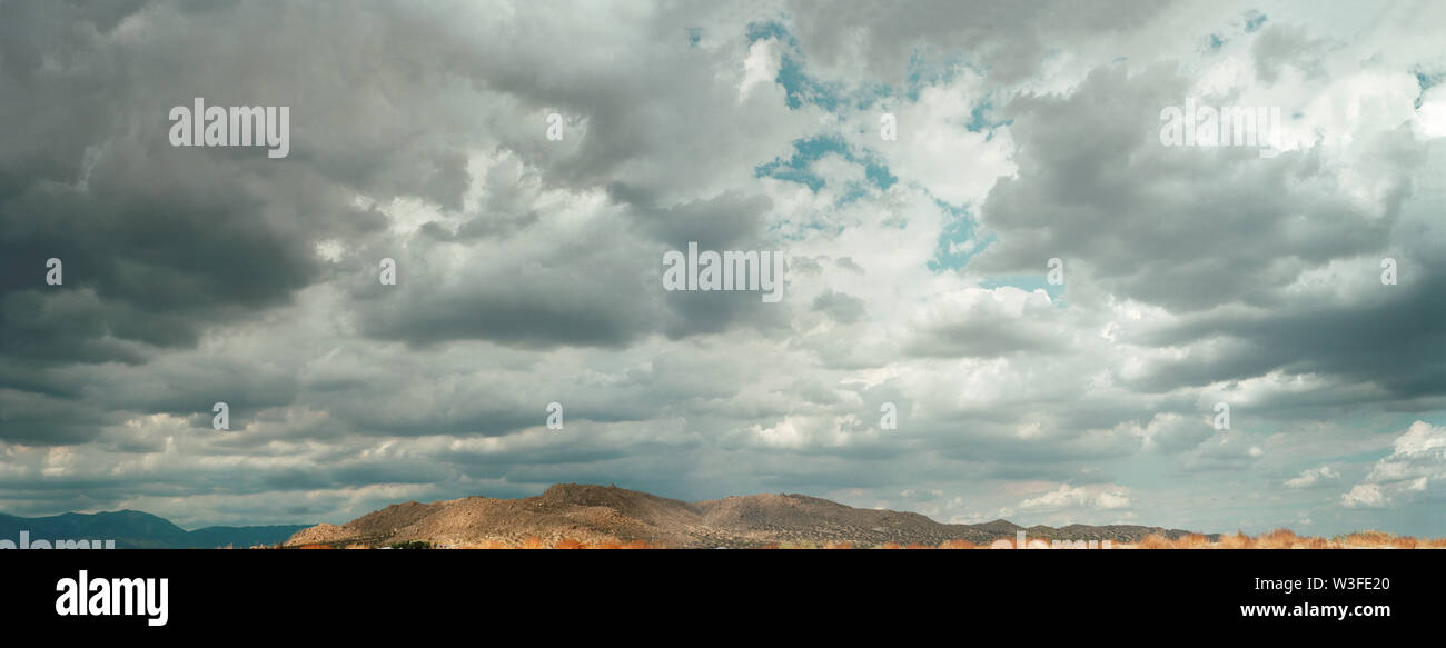 Cloud formation above mountains. - Stock Image