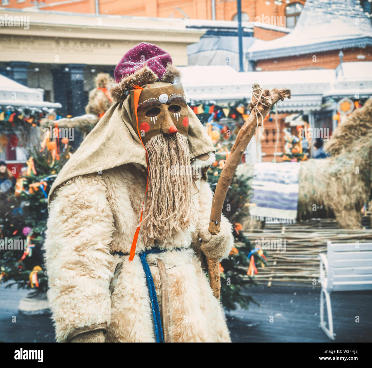 MOSCOW, RUSSIA- FEBRUARY 2017: The mummer walk the streets and entertain the people. Disguised in the wood goblin, the actor play the role of - Stock Image