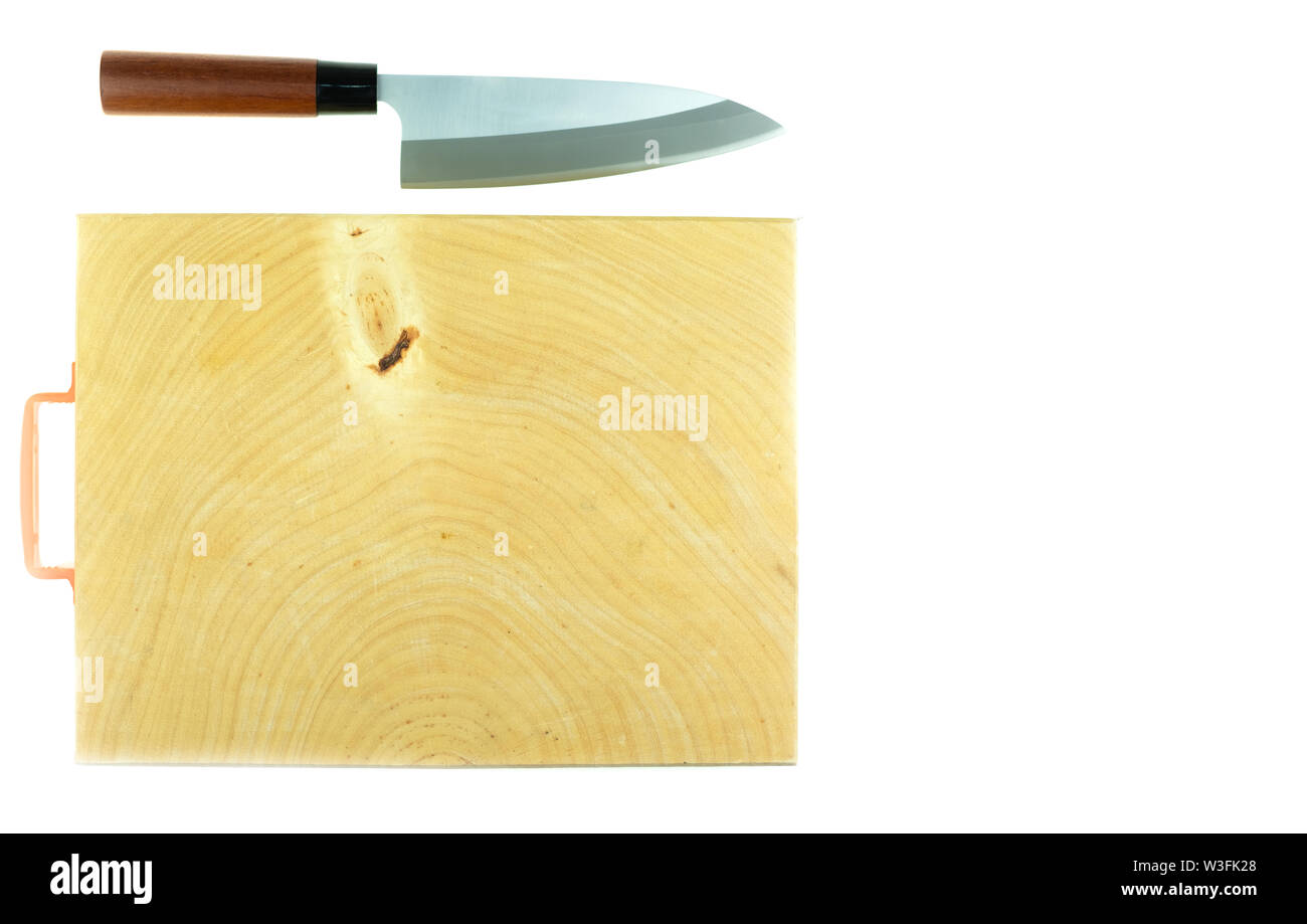 Japanese kitchen deba knife and wood butcher block countertop on white background - Stock Image