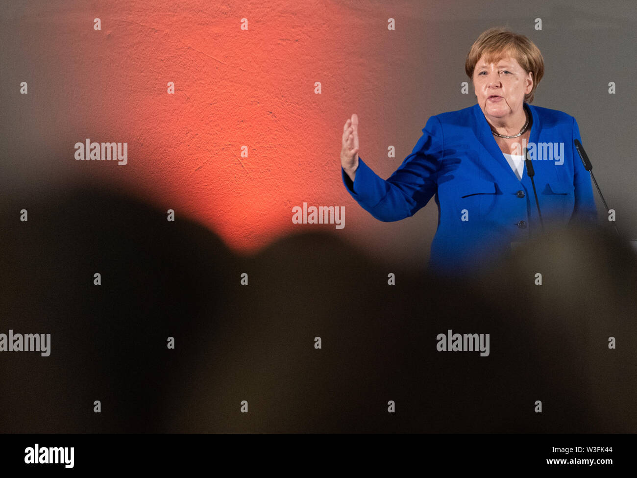 Dresden, Germany. 15th July, 2019. Chancellor Angela Merkel (CDU) speaks at the women's network meeting in the Albertinum. One and a half months before the state elections in Saxony, Merkel visits the Siemens plant in the Neisse town of Görlitz and a women's network meeting in the state capital. Credit: Robert Michael/dpa-Zentralbild/dpa/Alamy Live News - Stock Image