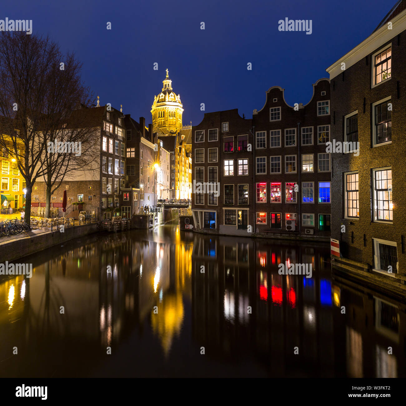Amsterdam Canals and Saint Nicholas church sunset Netherlands - Stock Image