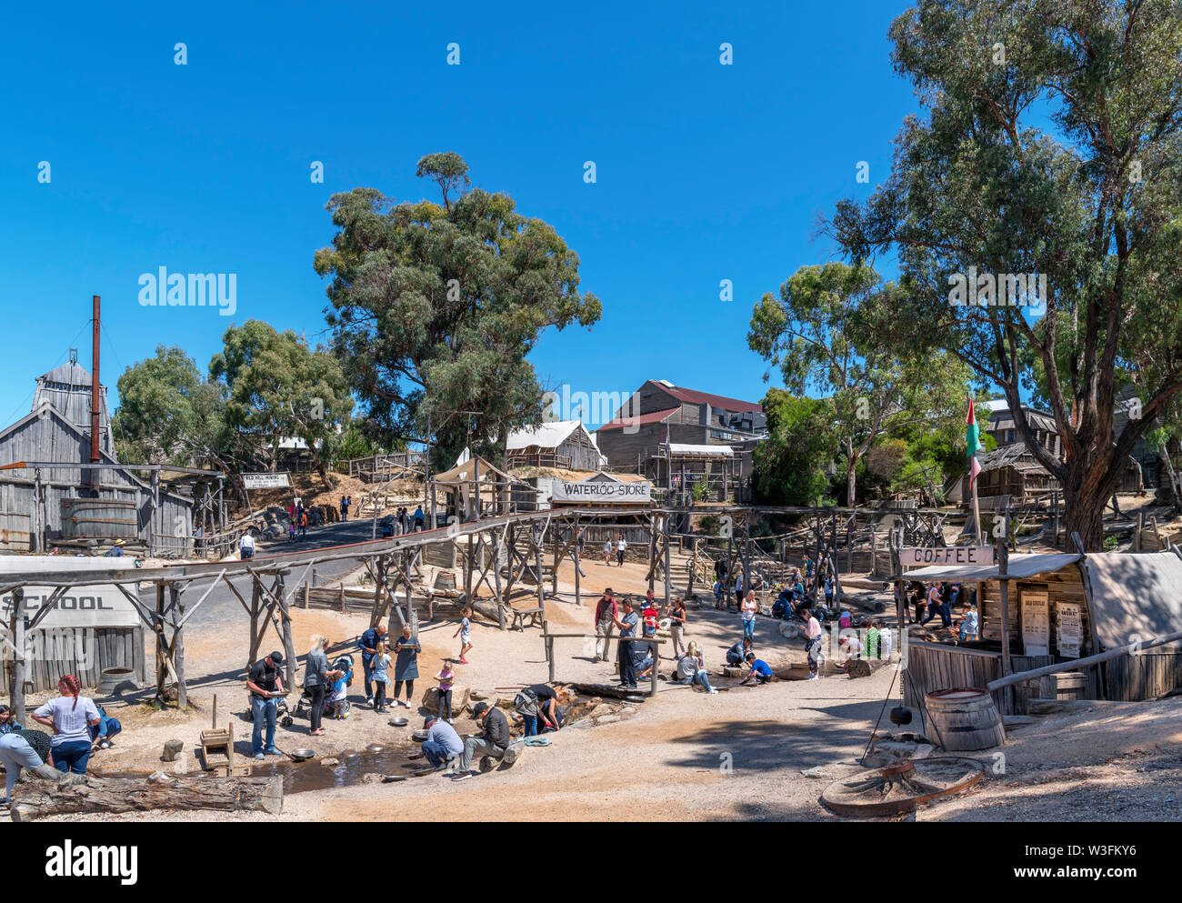 Visitors panning for gold at Sovereign Hill, an open air museum in the old gold mining town of Ballarat, Victoria, Australia - Stock Image