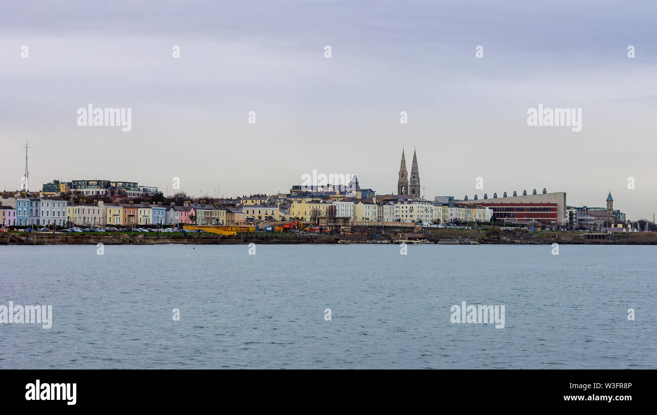 Colorful skyline of Dun Laoghaire, Ireland taken from Forty Foot near Sandycove - Stock Image