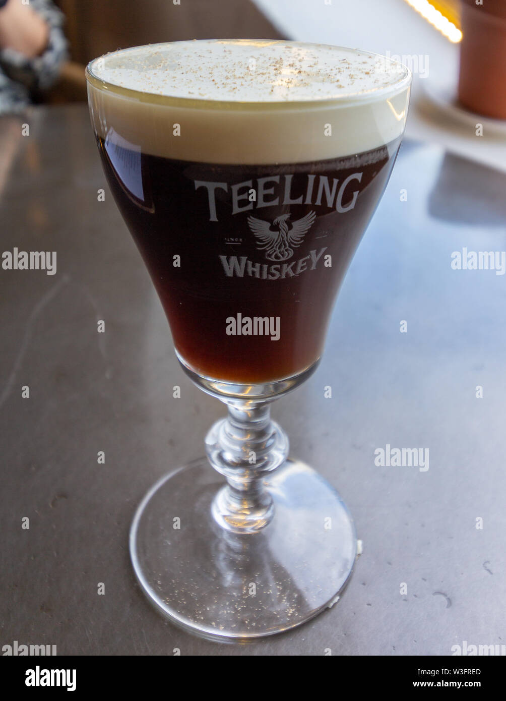 Dublin, Ireland - January 20, 2019 - In the Teeling Distillery tasting room whiskey based cocktails can be purchased. Pictured is an Irish coffee in l - Stock Image