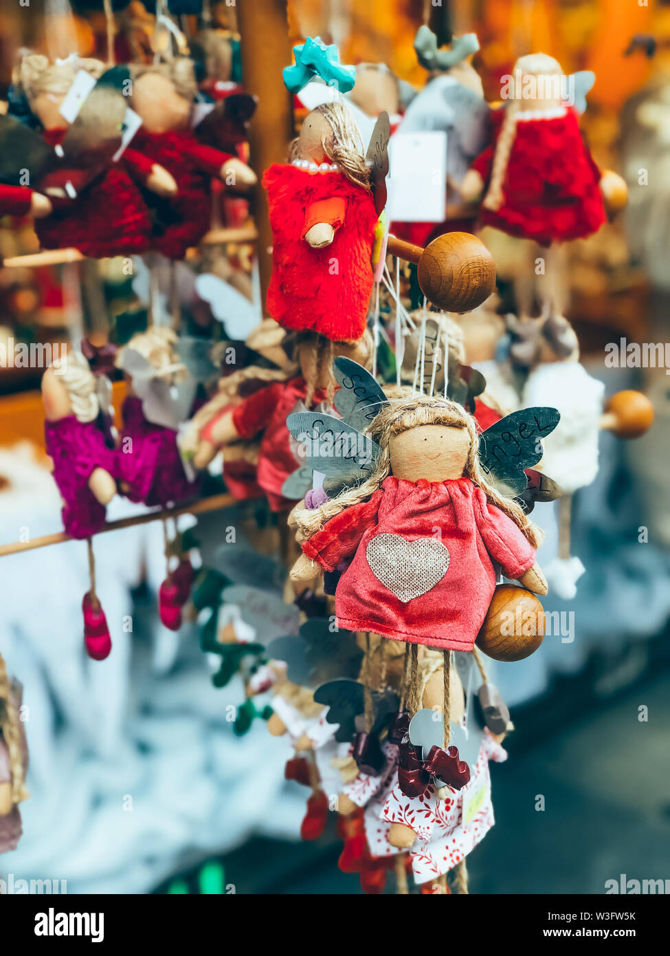 Beautiful Christmas tree decoration on outdoor Christmas market in Munich. Mobile photo - Stock Image
