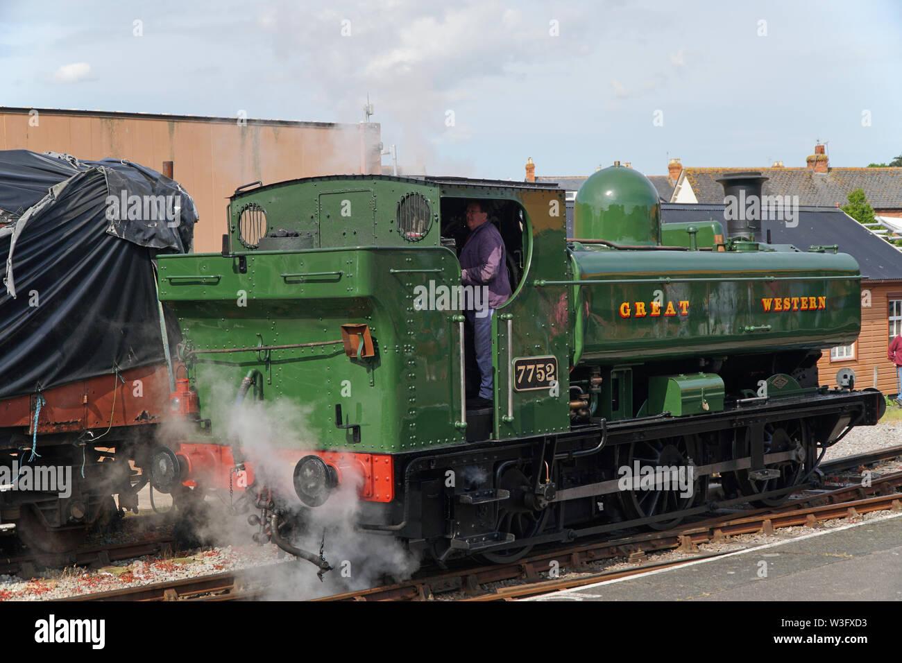 Great Western vintage steam engine 7752 at Minehead station - Stock Image