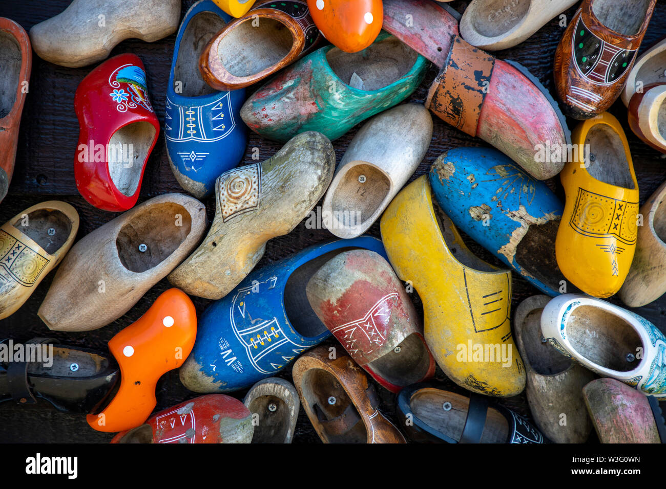 Zaanse Schans, Netherlands, historical village, open-air museum in North Holland, old windmills, workshops, farms, houses, typical Dutch wooden shoes, - Stock Image
