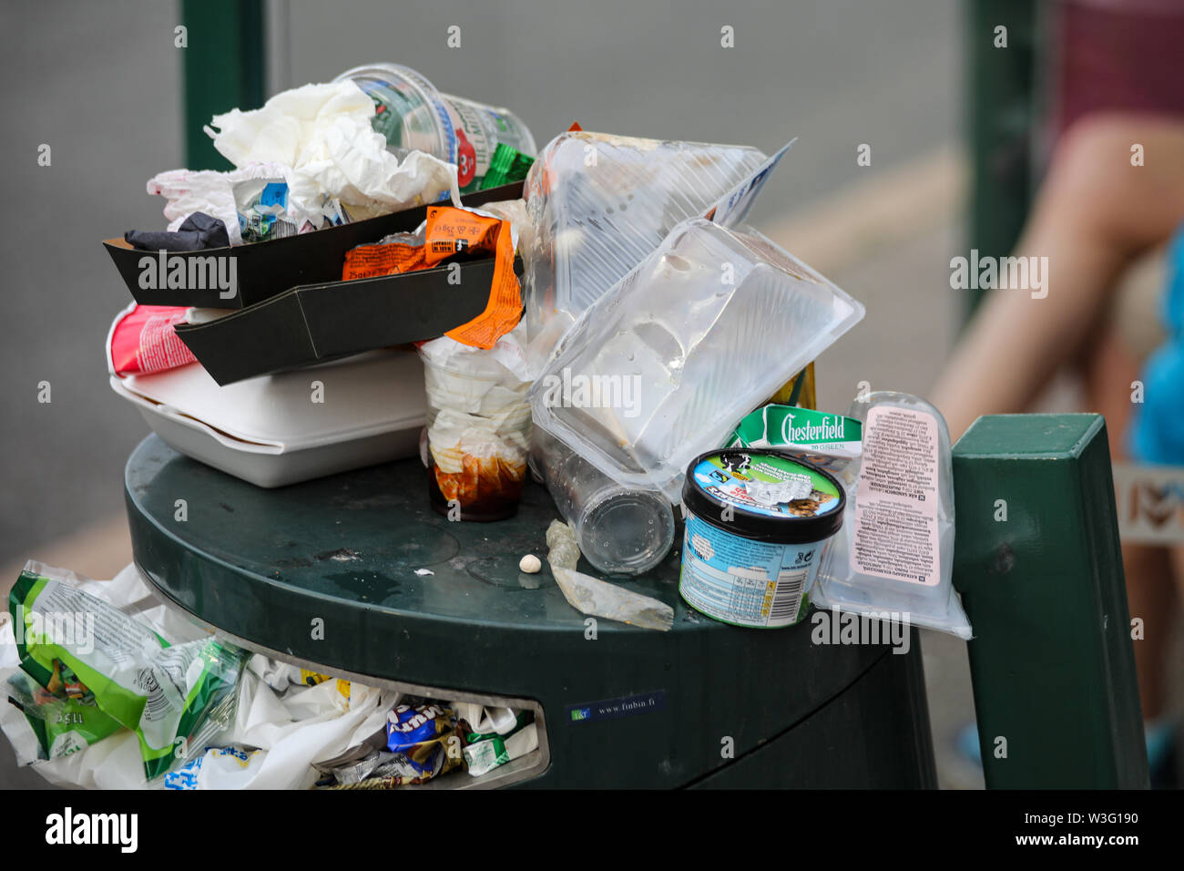 Overfilled litterbin in Hakaniemi district during Kallio Block Party 2018 in Helsinki, Finland - Stock Image
