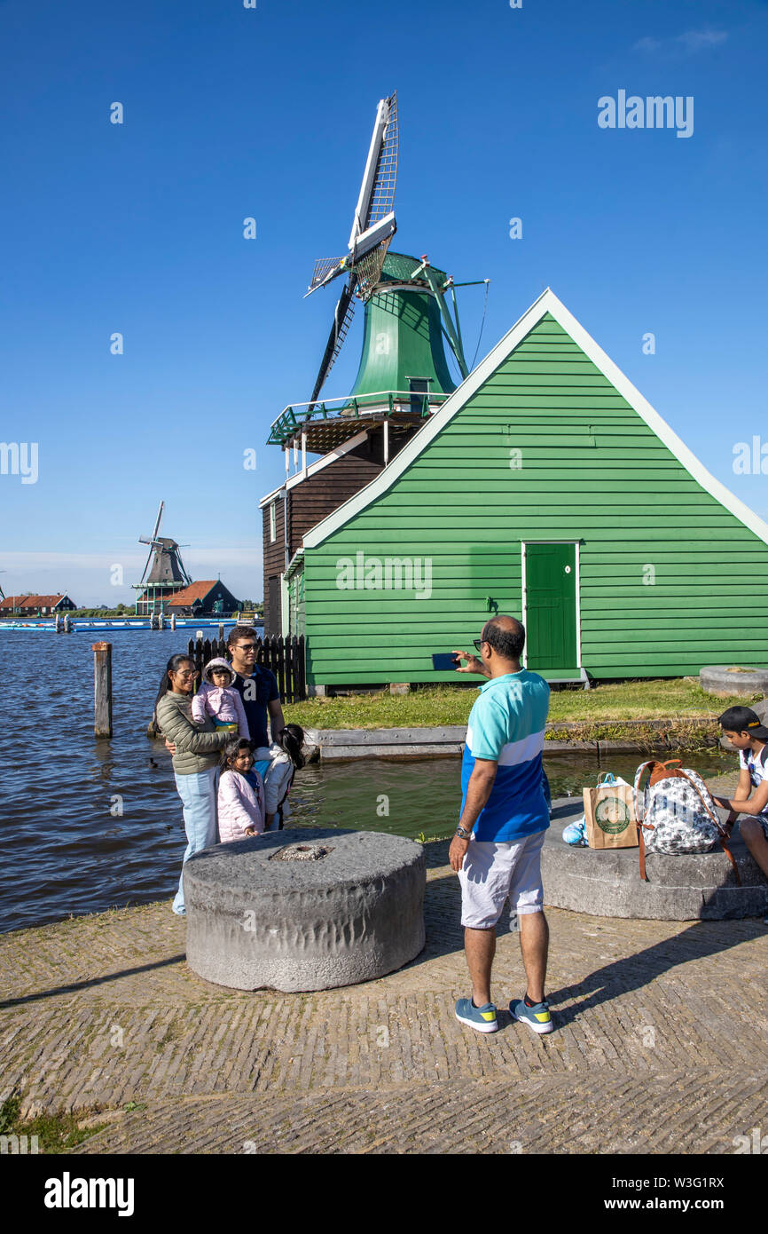 Zaanse Schans, Netherlands, historical village, open-air museum in North Holland, old windmills, workshops, farms, residential houses, tourists, souve - Stock Image