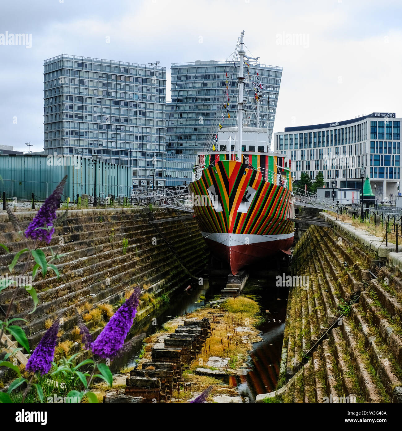 'Dazzle Ship' in Canning Graving dock, Liverpool, UK by Venezuelan artist Carlos Cruz-Diez. He painted the pilot ship 'Edmund Gardner' in the dazzle s - Stock Image