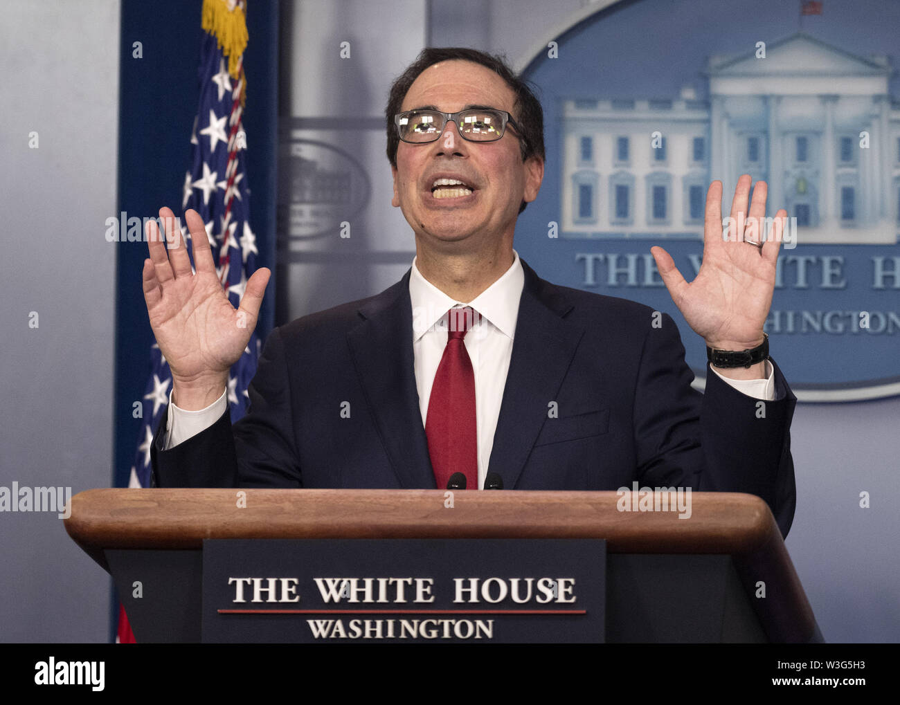 Washington, District of Columbia, USA. 15th July, 2019. United States Secretary of the Treasury Steven T. Mnuchin gestures as he holds a press briefing in the Brady Press Briefing Room of the White House in Washington, DC on Monday, July 15, 2019. Sec. Mnuchin was discussing digital assets, including cryptocurrency, such as Bitcoin or Libra Credit: Ron Sachs/CNP/ZUMA Wire/Alamy Live News - Stock Image