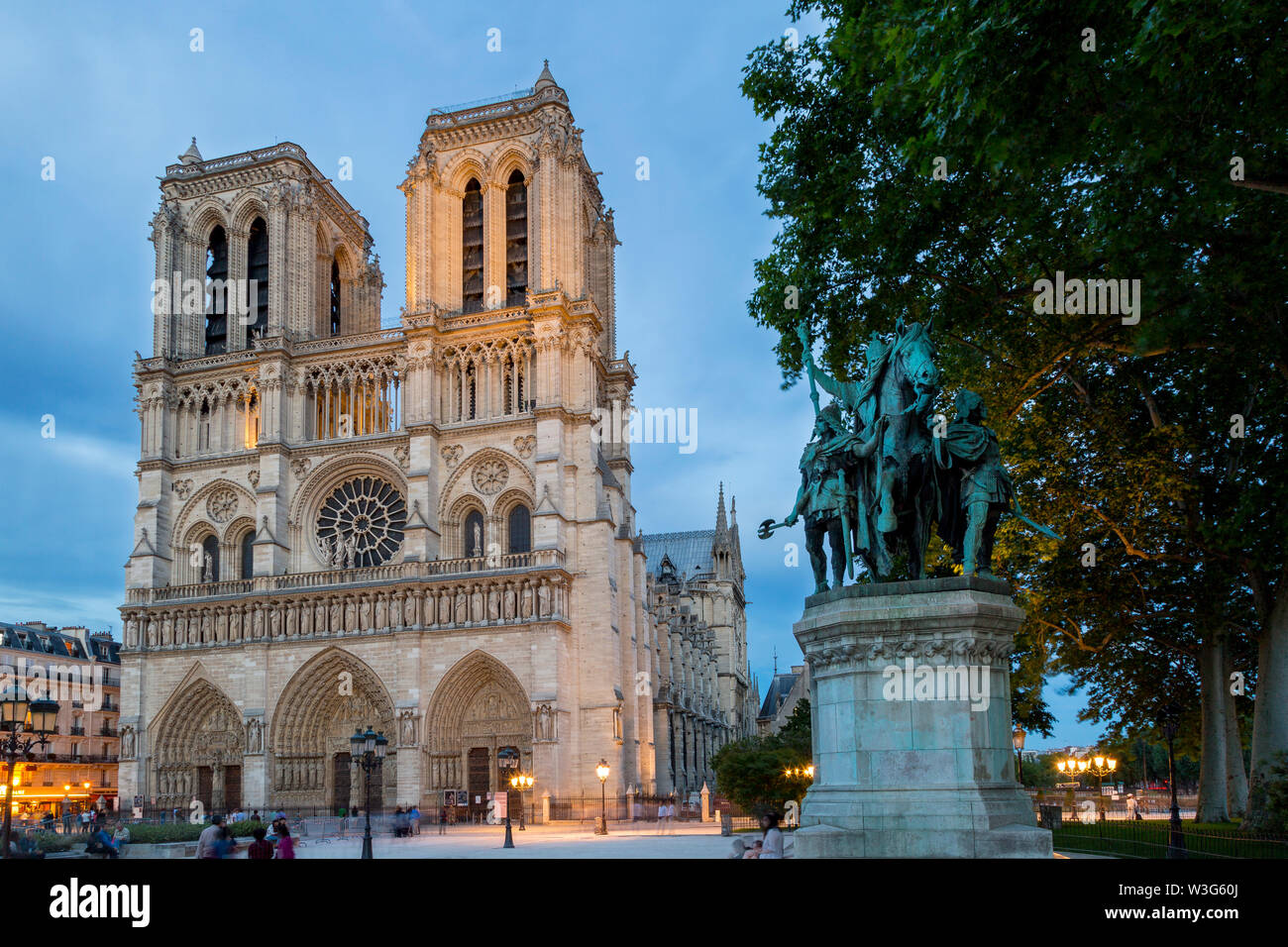 Charlemagne statue below the front facade of Cathedral Notre Dame, Paris France - Stock Image