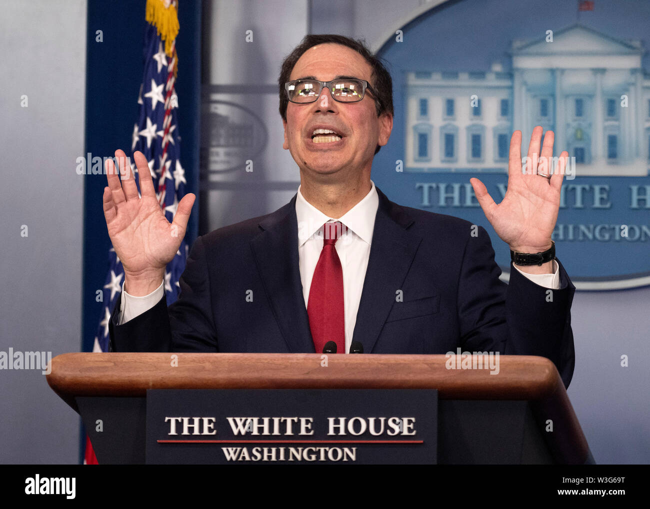 United States Secretary of the Treasury Steven T. Mnuchin gestures as he holds a press briefing in the Brady Press Briefing Room of the White House in Washington, DC on Monday, July 15, 2019. Sec. Mnuchin was discussing digital assets, including cryptocurrency, such as Bitcoin or Libra.Credit: Ron Sachs/CNP /MediaPunch - Stock Image
