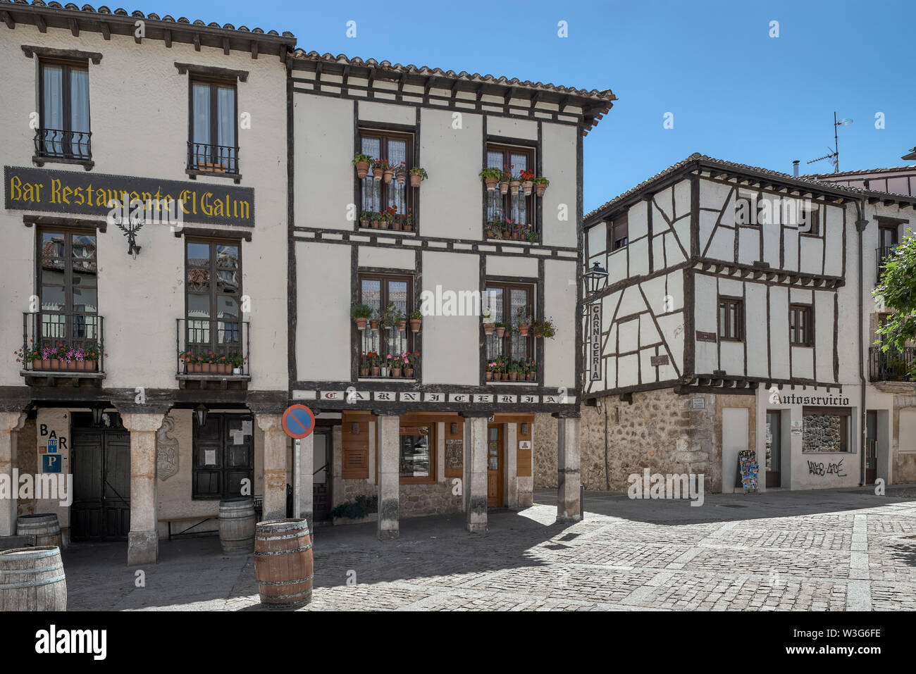 bar, restaurant, butcher and self-service in the Plaza dora Urraca in the town of Covarrubias in the province of Burgos, Spain, Europe - Stock Image