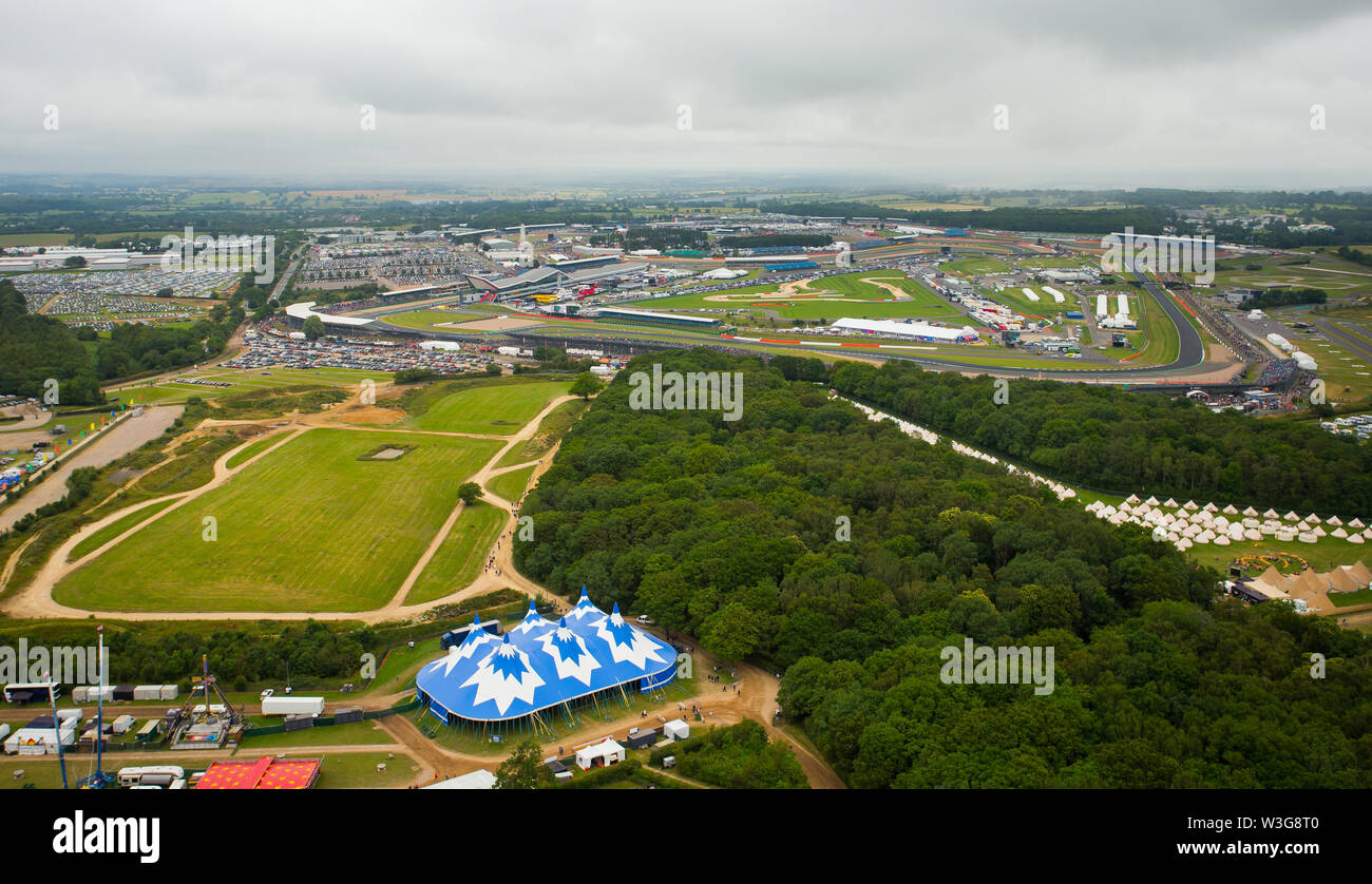 An aerial view of Silverstone Woodlands Campsite on the edge of Silverstone Circuit on F1 race day 2019 from a helicopter above the Northamptonshire c - Stock Image