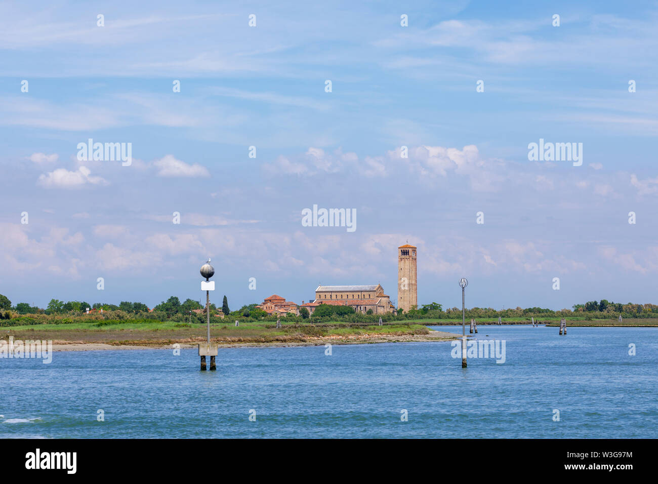 View of Torcello, a small island in Venice Lagoon, Venice, Italy with the Cathedral of Santa Maria Assunta, Santa Fosca and campanile (bell tower) - Stock Image