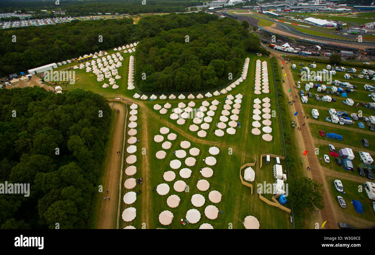 An aerial view of the Luxury Glamping bell tent field at Silverstone Woodlands Campsite on the edge of Silverstone Circuit on F1 race day 2019 from a - Stock Image