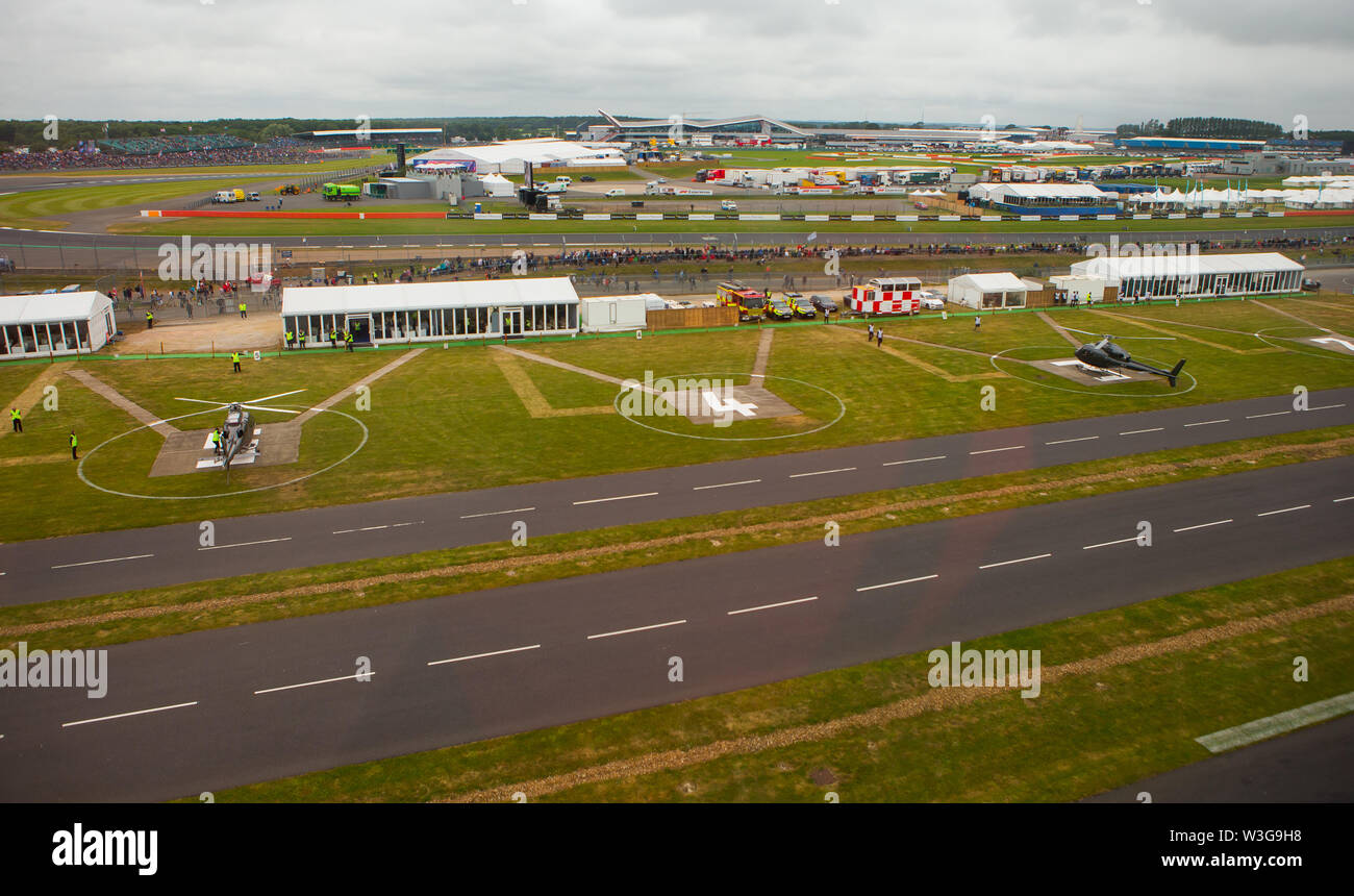 An aerial view of the heliport at Silverstone Circuit on F1 race day 2019 from a helicopter above the Northamptonshire circuit. - Stock Image