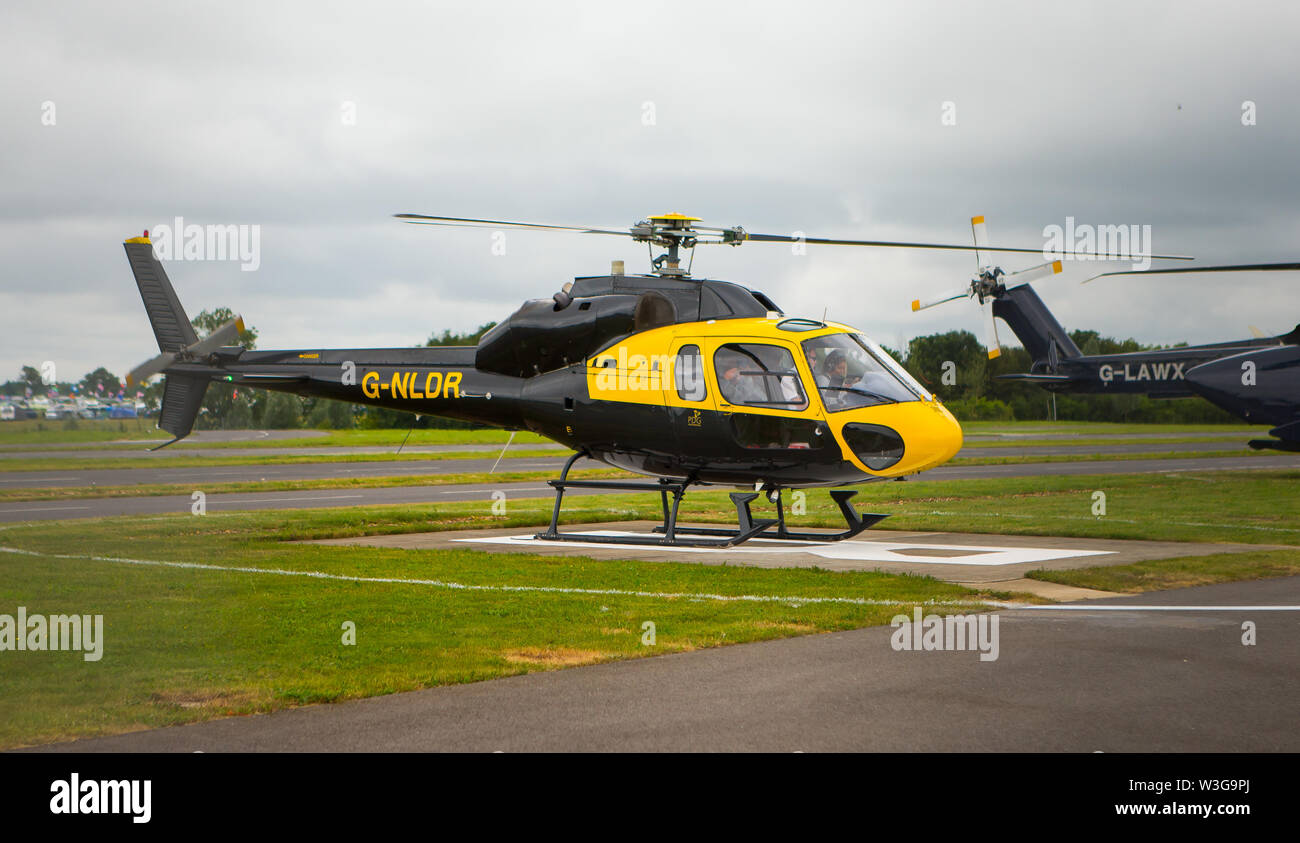 A AŽrospatiale AS 355F2 Ecureuil 2 helicopter G-NLDR on the heliport at Silverstone Circuit on F1 race day 2019 at the Northamptonshire circuit. - Stock Image
