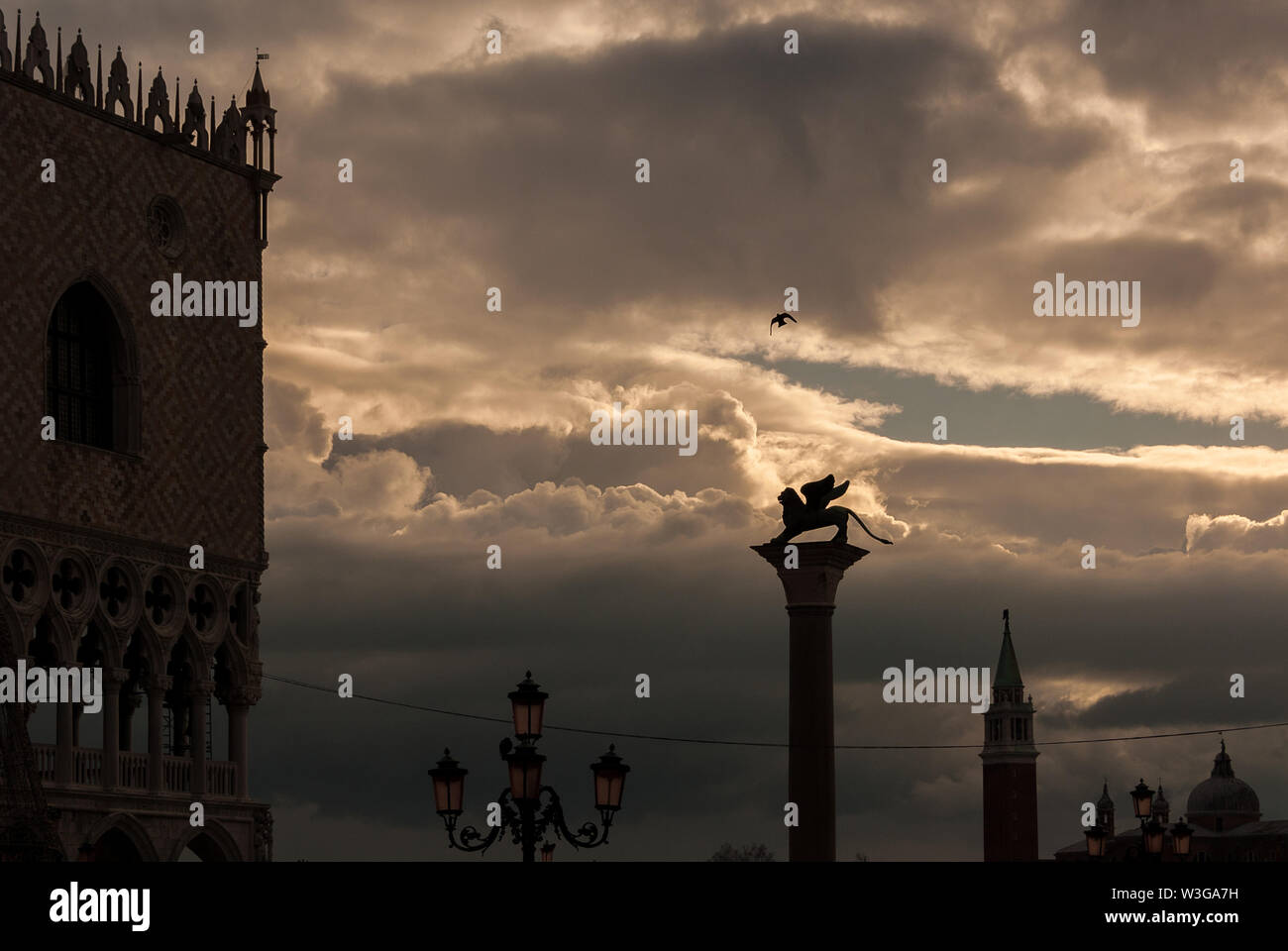 Beautiful clouds over Saint Marl Square monuments in Venice - Stock Image