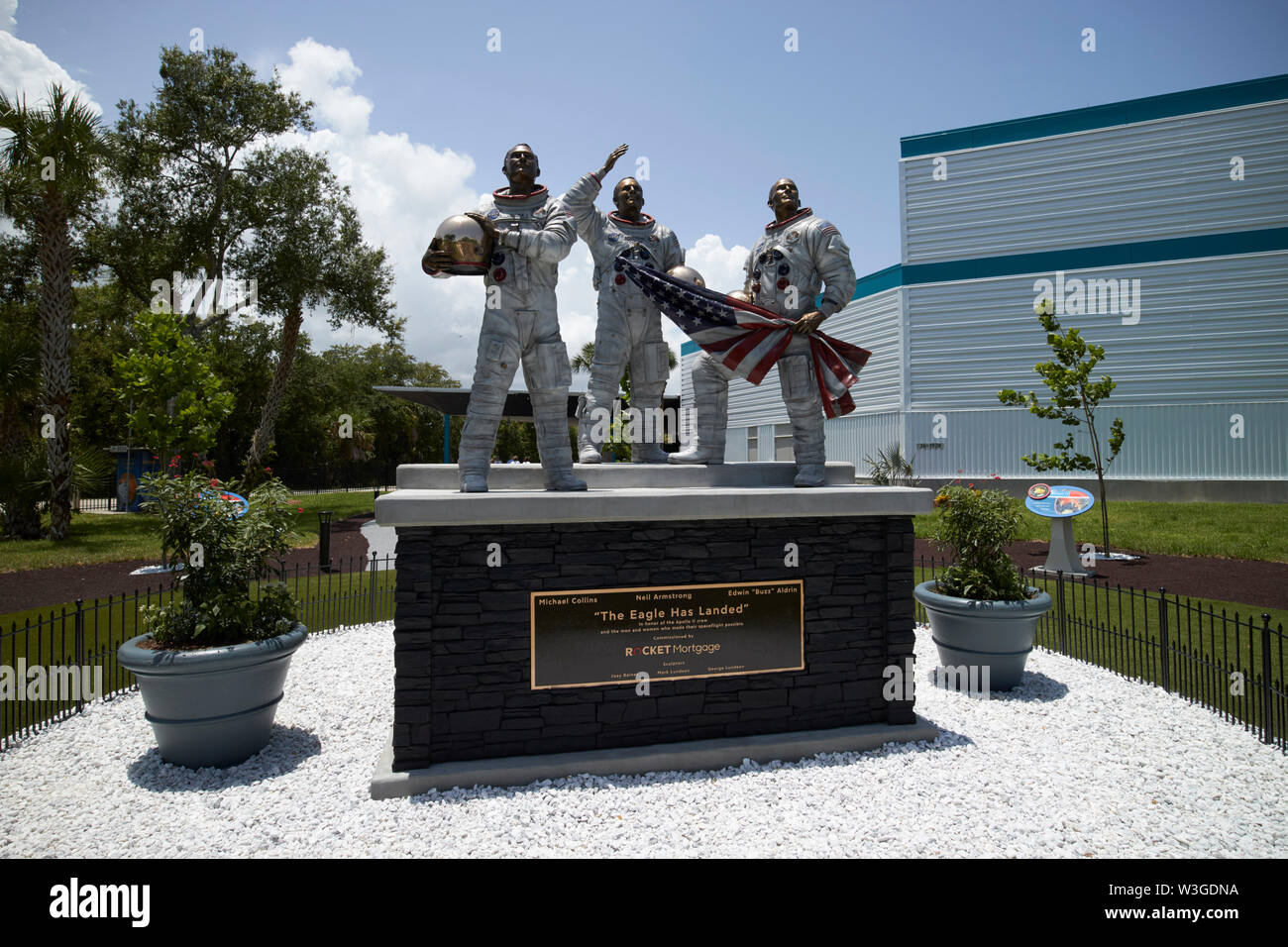 The eagle has landed sculpture of three astronauts in the new Moon Tree Garden in the Apollo/Saturn 5 center Kennedy Space Center Florida USA on the w - Stock Image