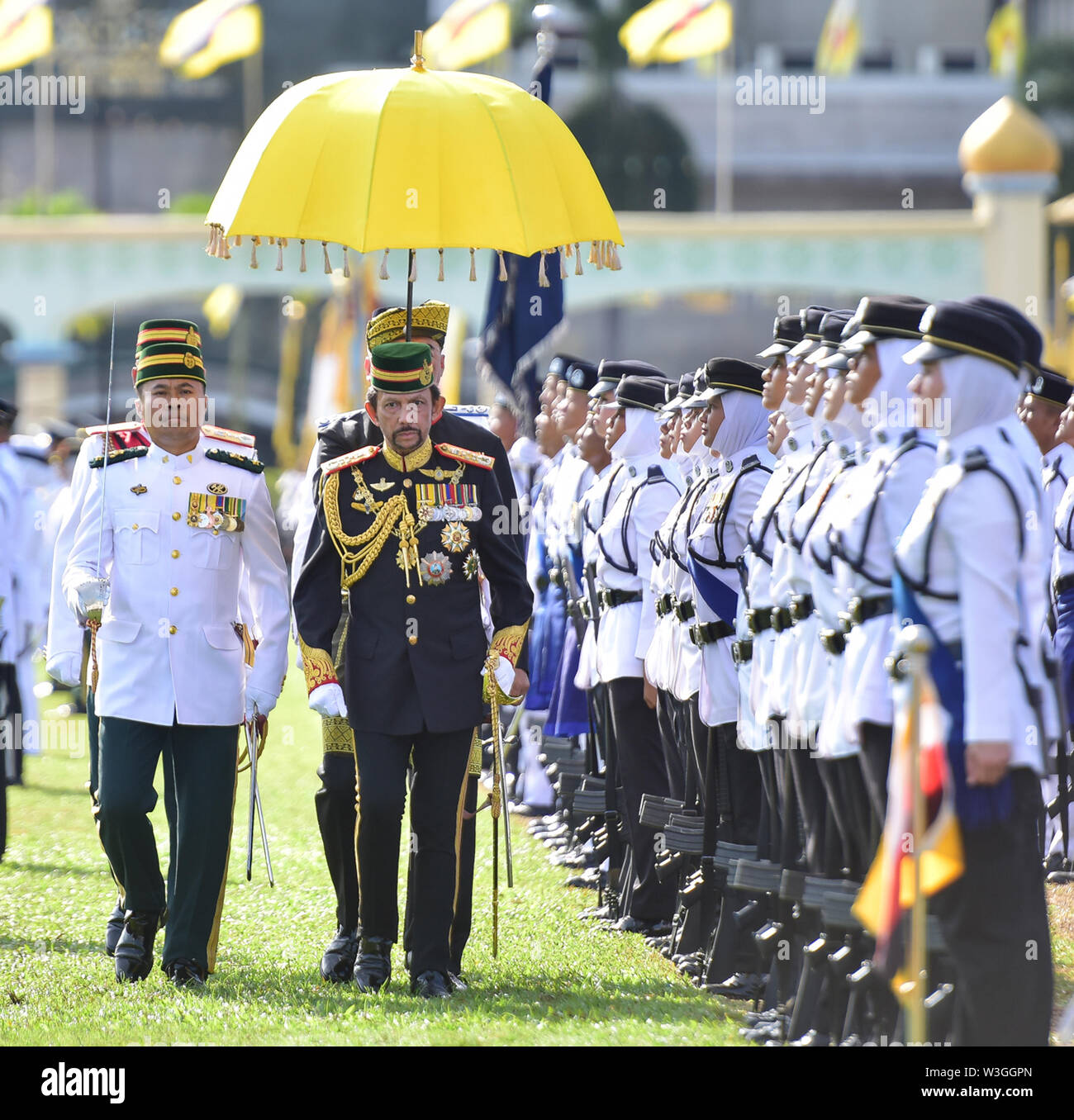 Bandar Seri Begawan, Brunei. 15th July, 2019. Brunei's Sultan Haji Hassanal Bolkiah inspects the guard of honor in Bandar Seri Begawan, Brunei, July 15, 2019. Brunei celebrated the Sultan Haji Hassanal Bolkiah's 73rd birthday with various activities including a ceremonial parade and a grand state banquet on Monday. The Sultan birthday is a national event held annually, which usually lasted about a month. Credit: Jeffrey Wong/Xinhua/Alamy Live News - Stock Image
