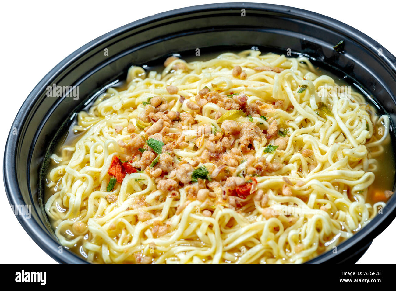Close up of noodles on the bowl isolated over white background - Stock Image