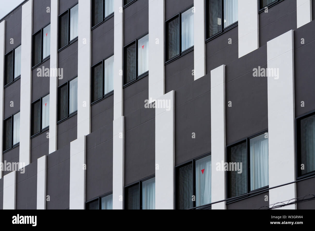 A modern office building abstract with black and white stripes. Yamato, Kanagawa, Japan. Wednesday July10th 2019 - Stock Image