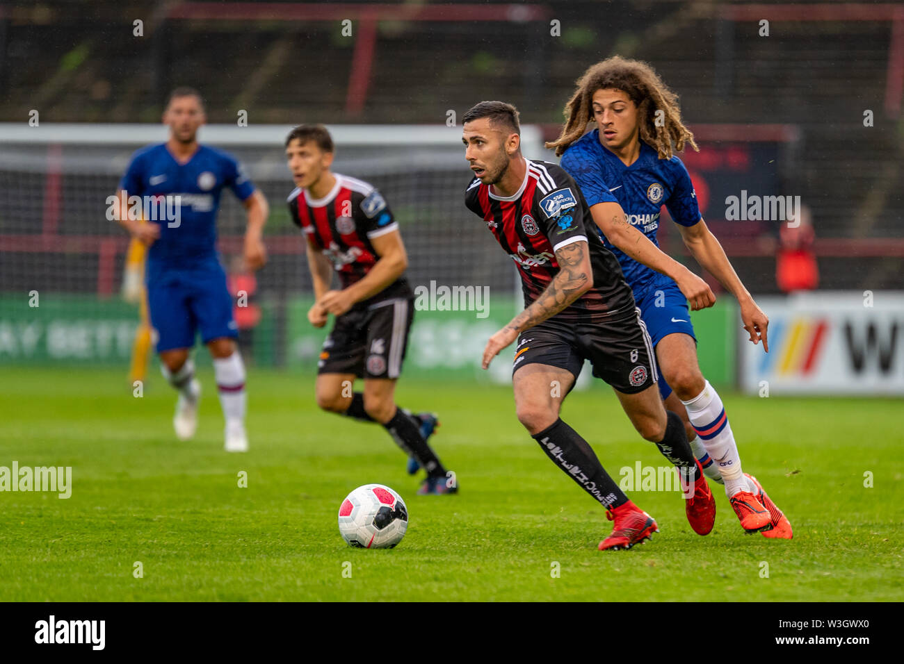 Ethan Ampadu (R) and Robbie McCourt (L) in action during Chelsea's pre season friendly match against Bohemian FC in Dublin. Final Score 1-1. - Stock Image