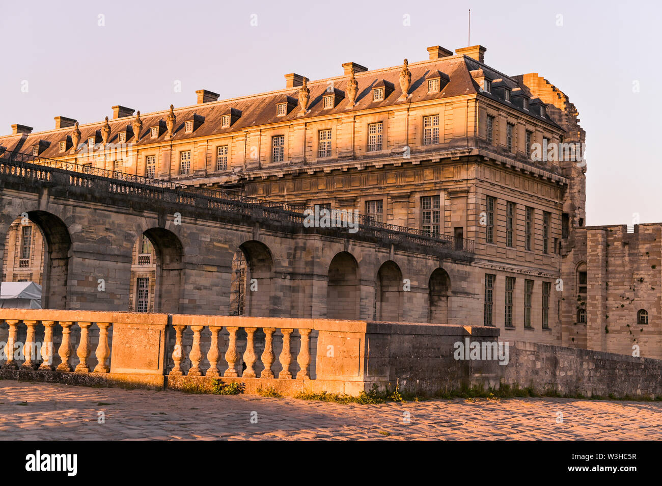 Vincennes Castle at sunset in the rays of the sun. An ancient castle in the south of France. Architecture and travel - Stock Image