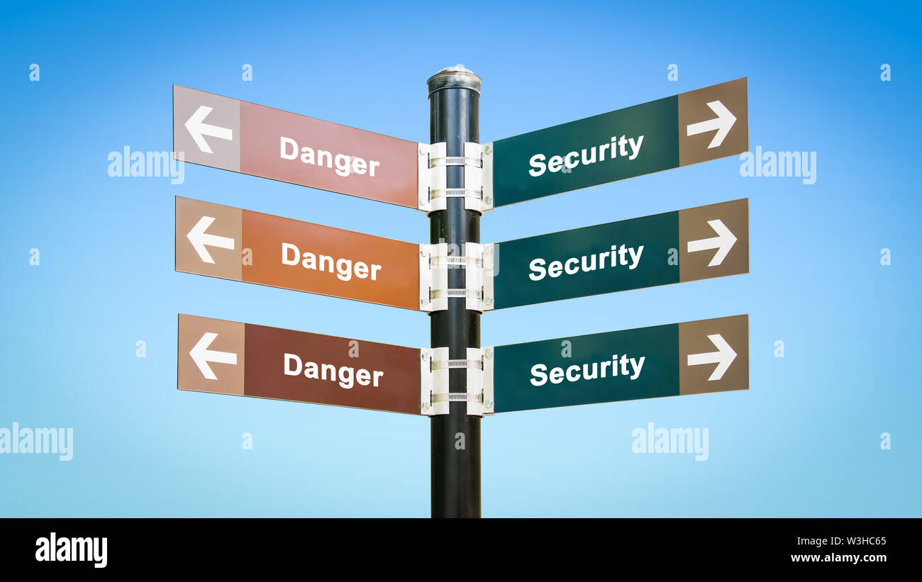 Street Sign the Direction Way to Security versus Danger - Stock Image
