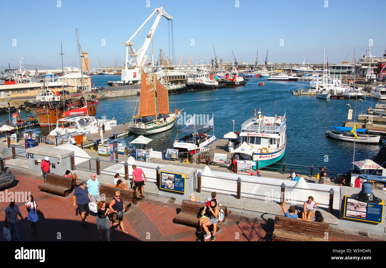 looking over or aerial view of the harbour area of the V&A Waterfront in Cape Town, South Africa where tourists enjoy the boat rides and lifestyle Stock Photo