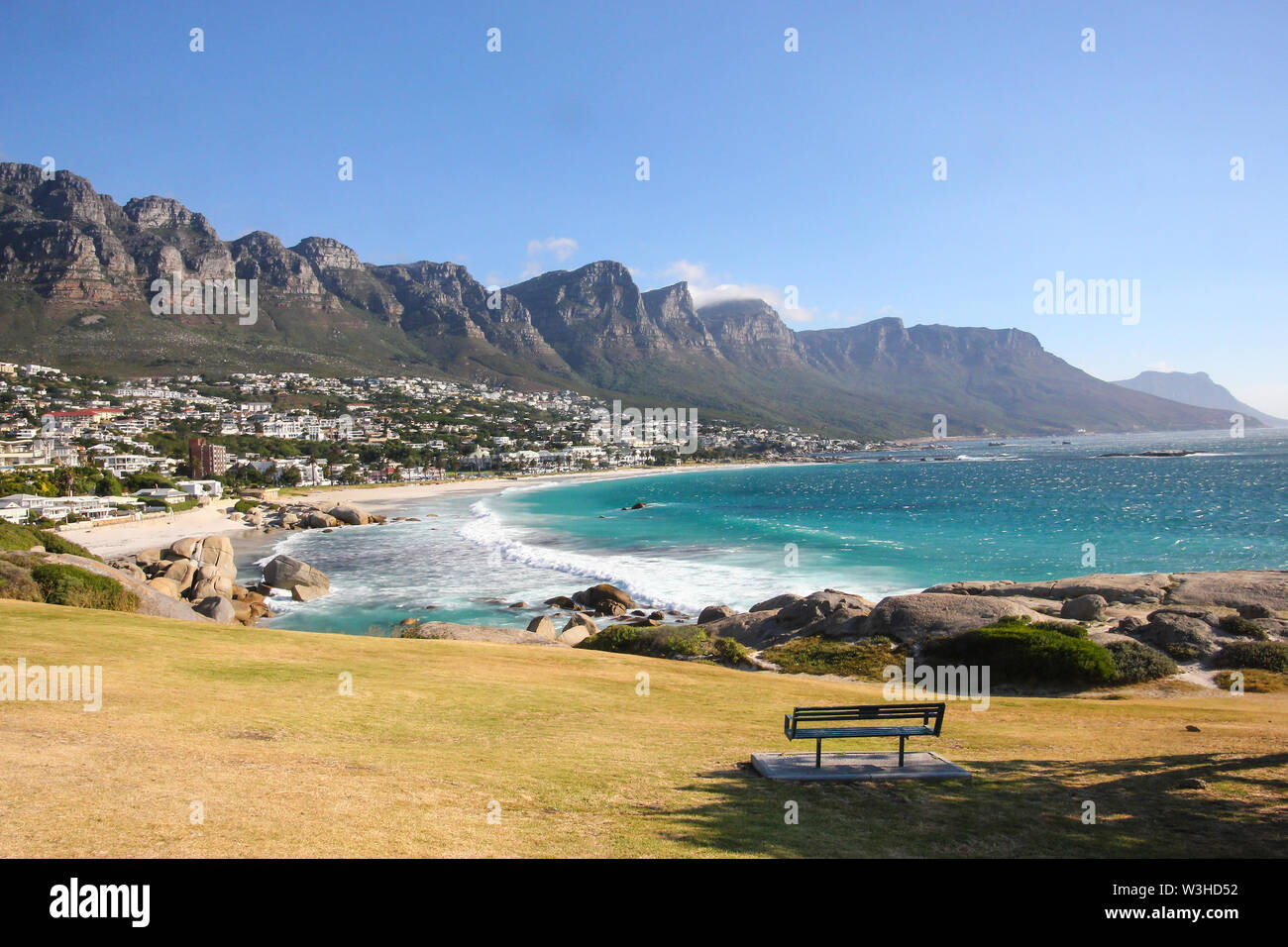landscape view over the Twelve Apostle mountains and Table Mountain national park and Camps Bay coastal suburb of Cape Town, South Africa Stock Photo