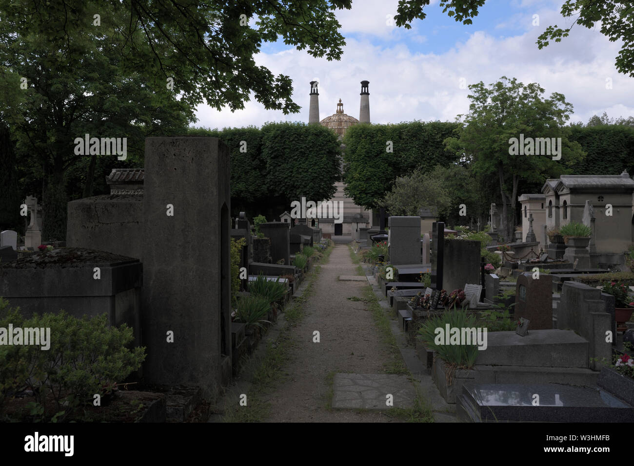 graves and the chimneys of the crematory at the Pere Lachaise Cemetery, Paris, France - Stock Image
