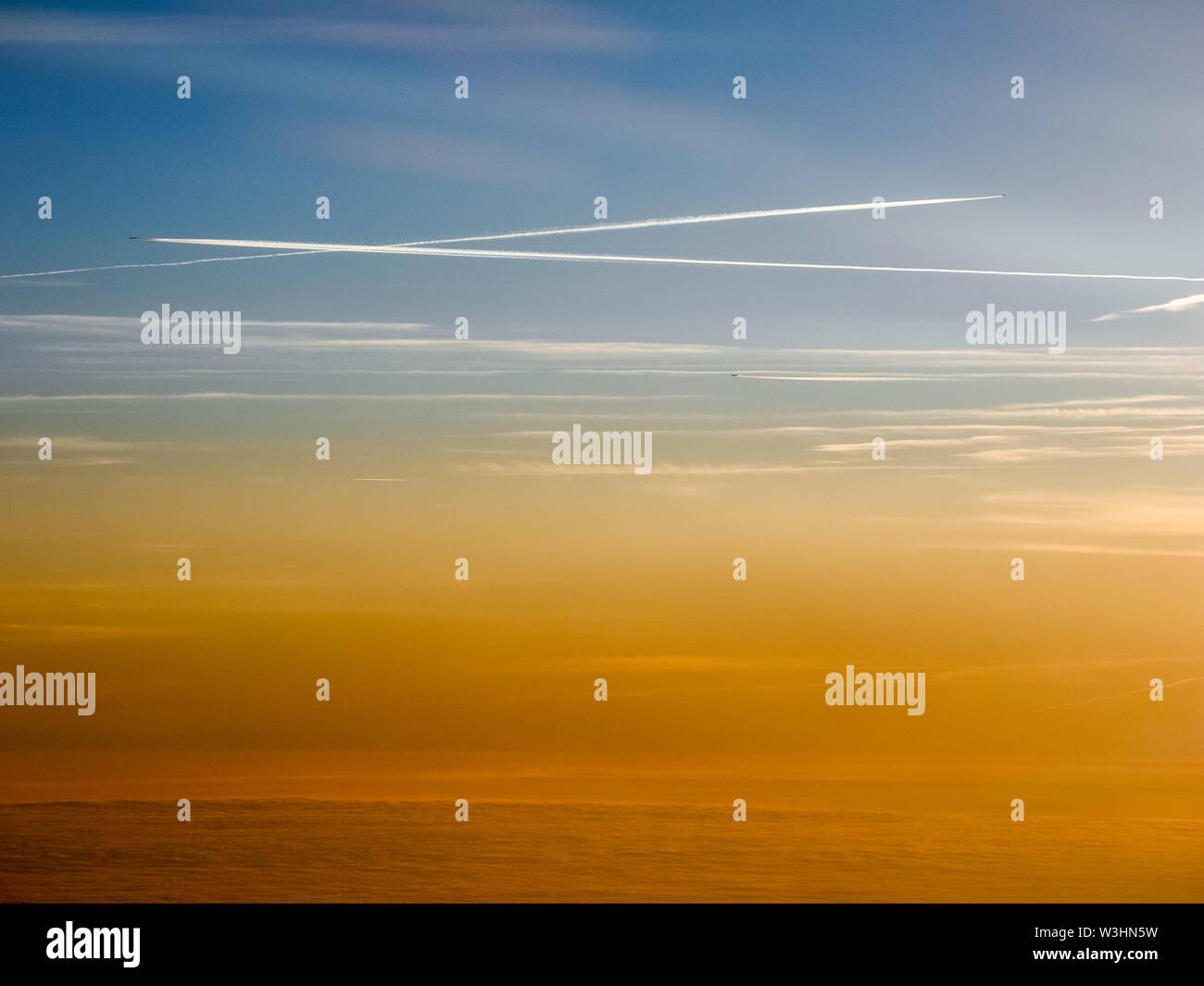 Aerial view of sunset and clouds over Europe - Stock Image