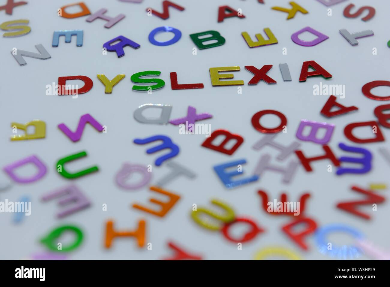 reading disability,learning disorder,language,dyslexia,decoding,read,learning,education,alphabet,word,abc,abstract,background,blue,color,colorful,copy - Stock Image