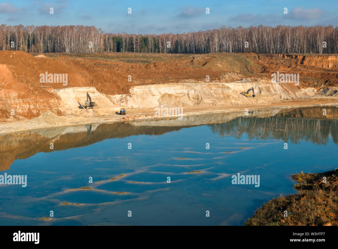 Top view of the place of extraction of sand in a sand pit in the autumn afternoon - Stock Image